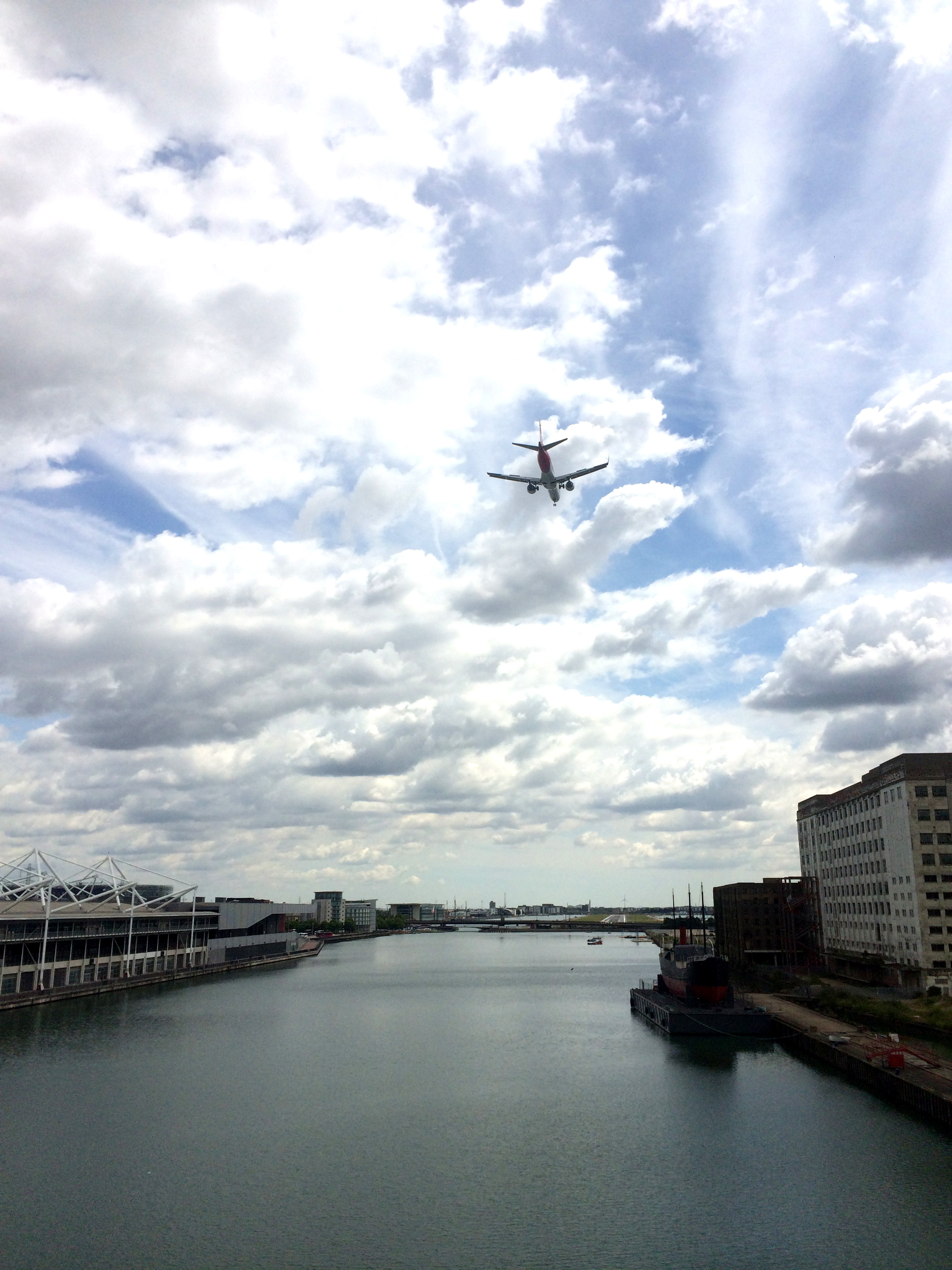 The plane flies over the Royal Docks to land