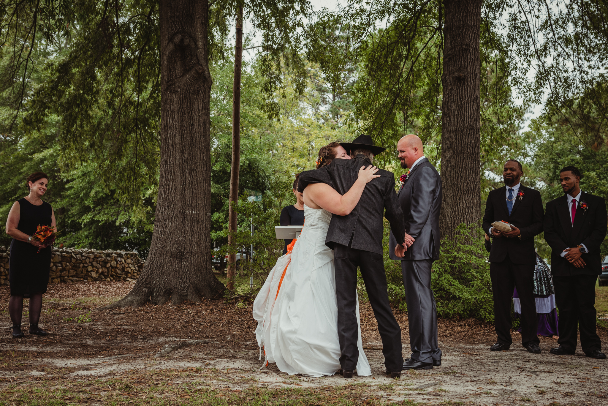 raleigh-wedding-father-hug-at-ceremony-cd.jpg