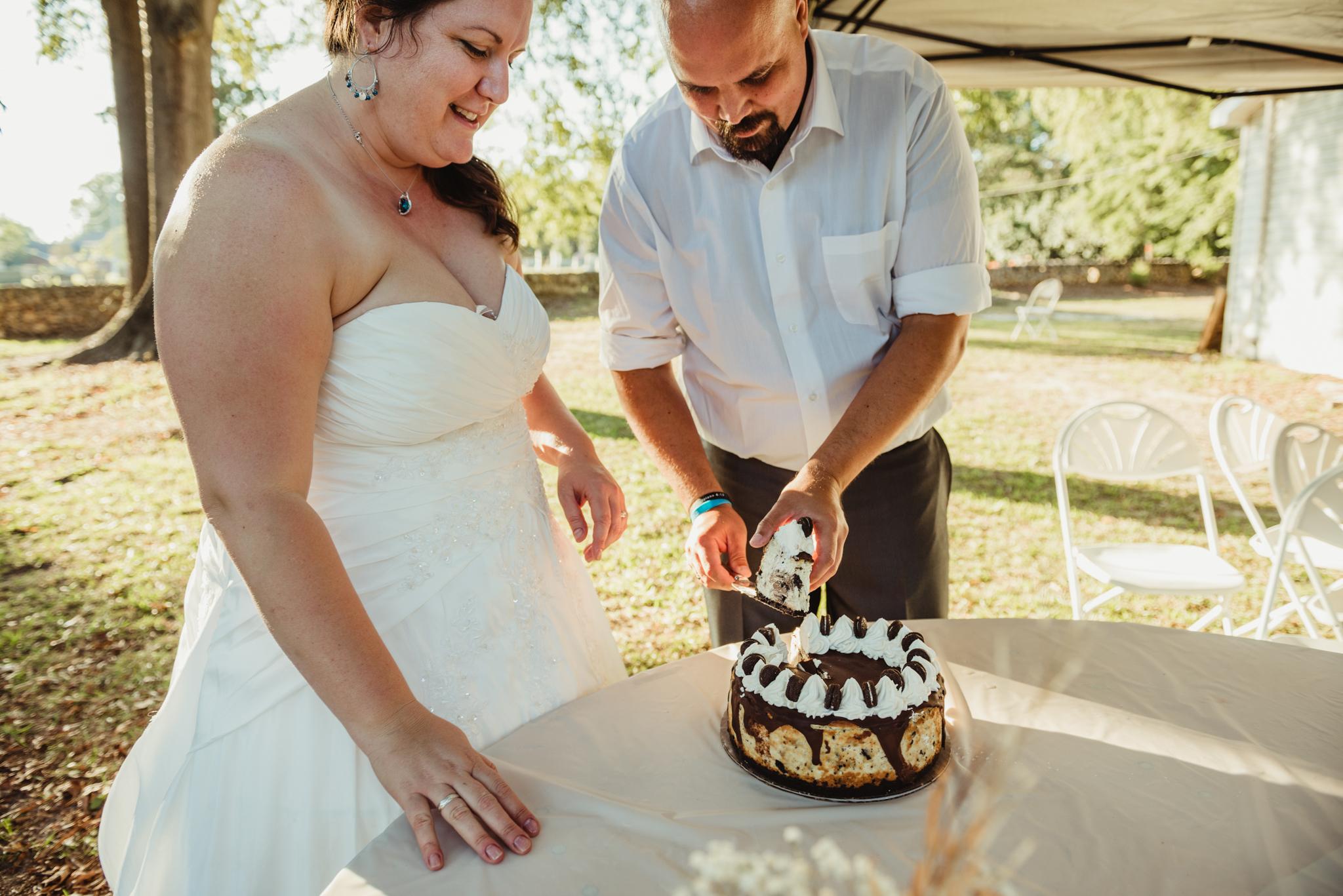 raleigh-wedding-outdoor-reception-cake-cutting-cd-1.jpg