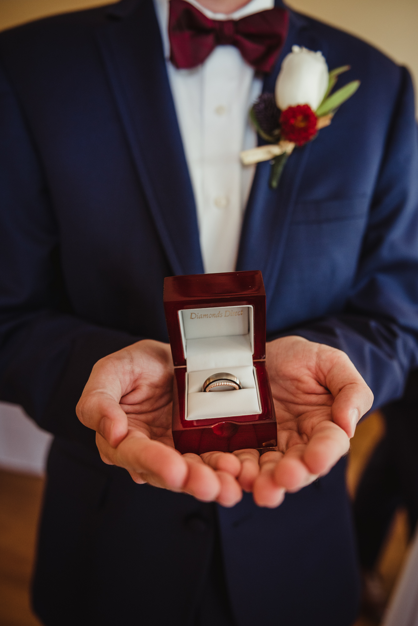 a-groomsman-holding-the-wedding-rings.jpg