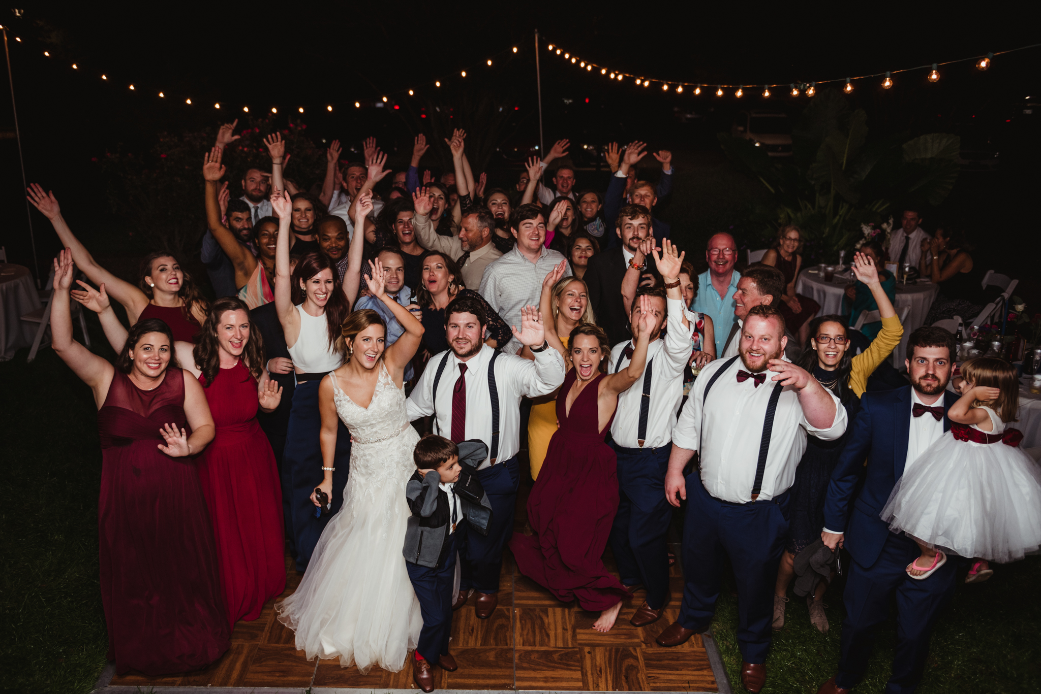 all-the-wedding-guests-in-a-group-picture-on-the-dance-floor.jpg