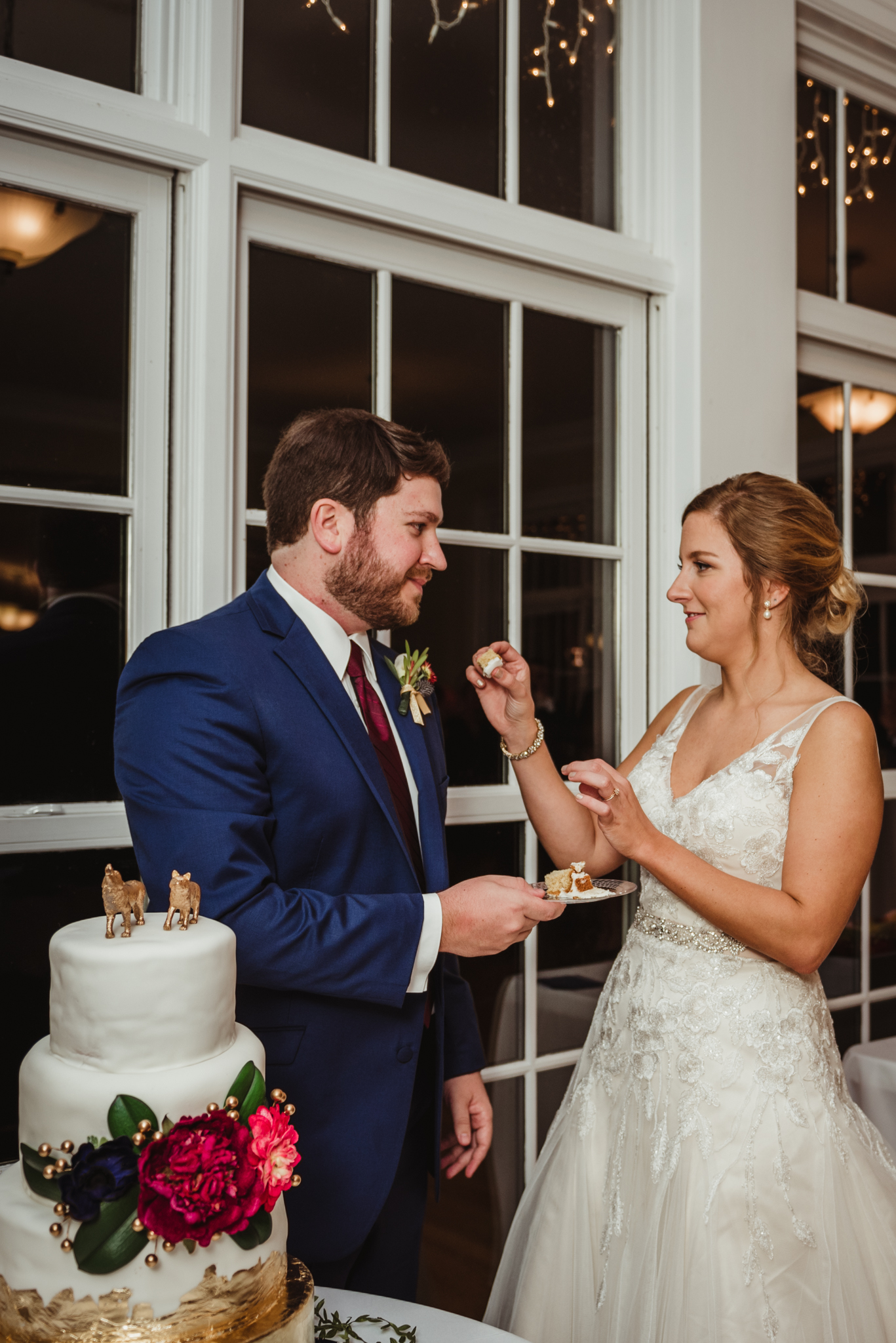 bride-and-groom-feeding-cake-to-each-other.jpg