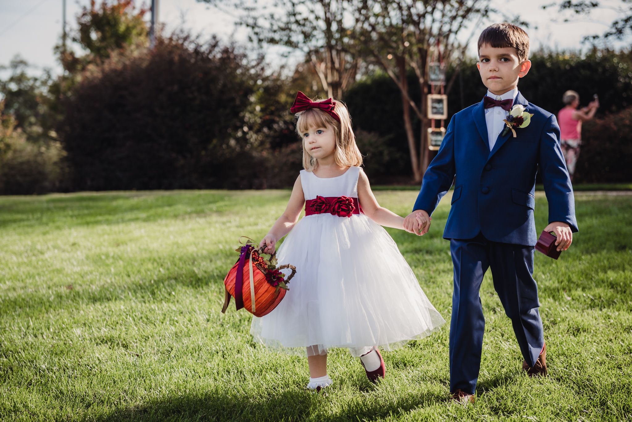 ring-bearer-and-flower-girl-holding-hands-down-the-aisle.jpg