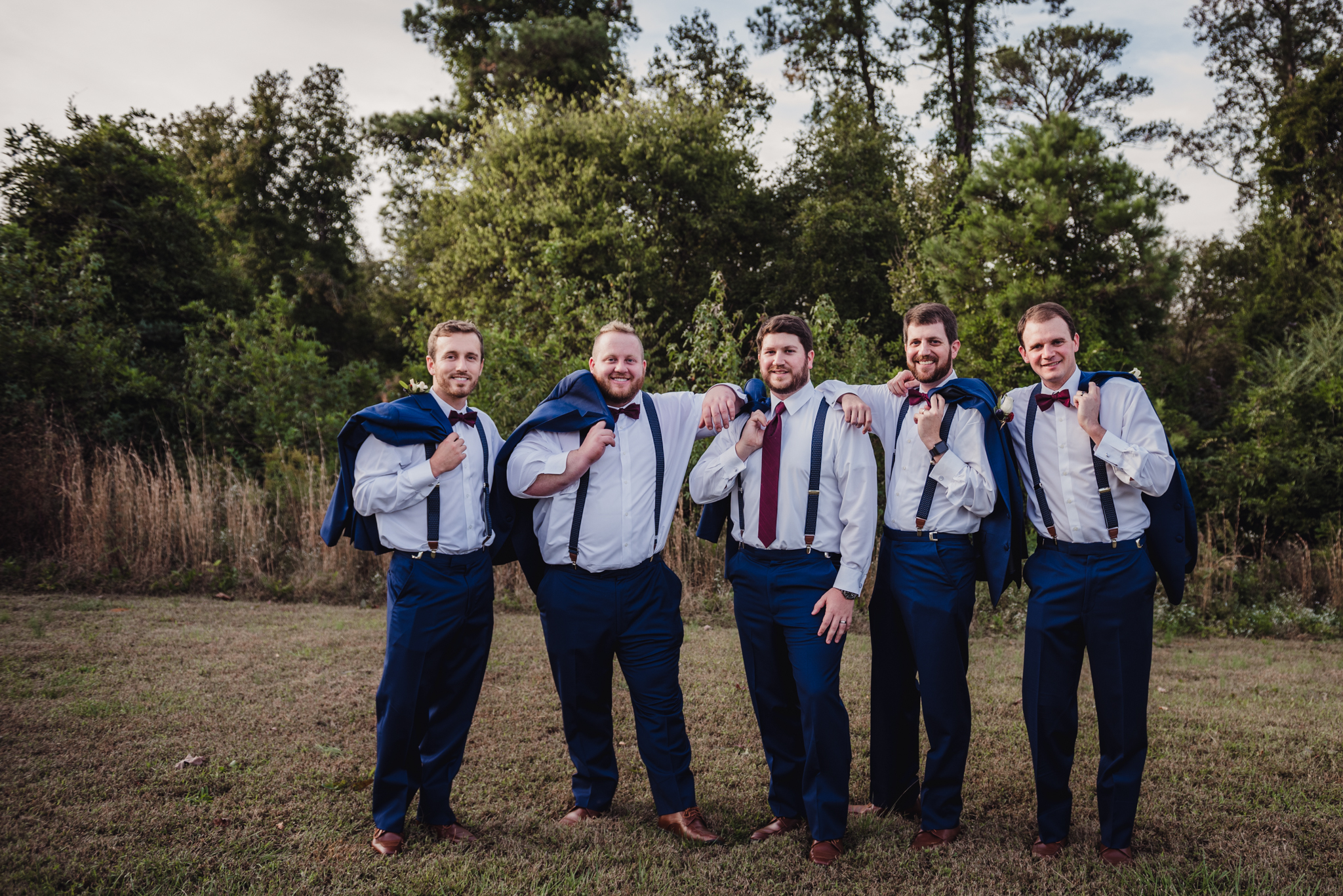 the-groomsmen-showing-off-their-suspenders.jpg