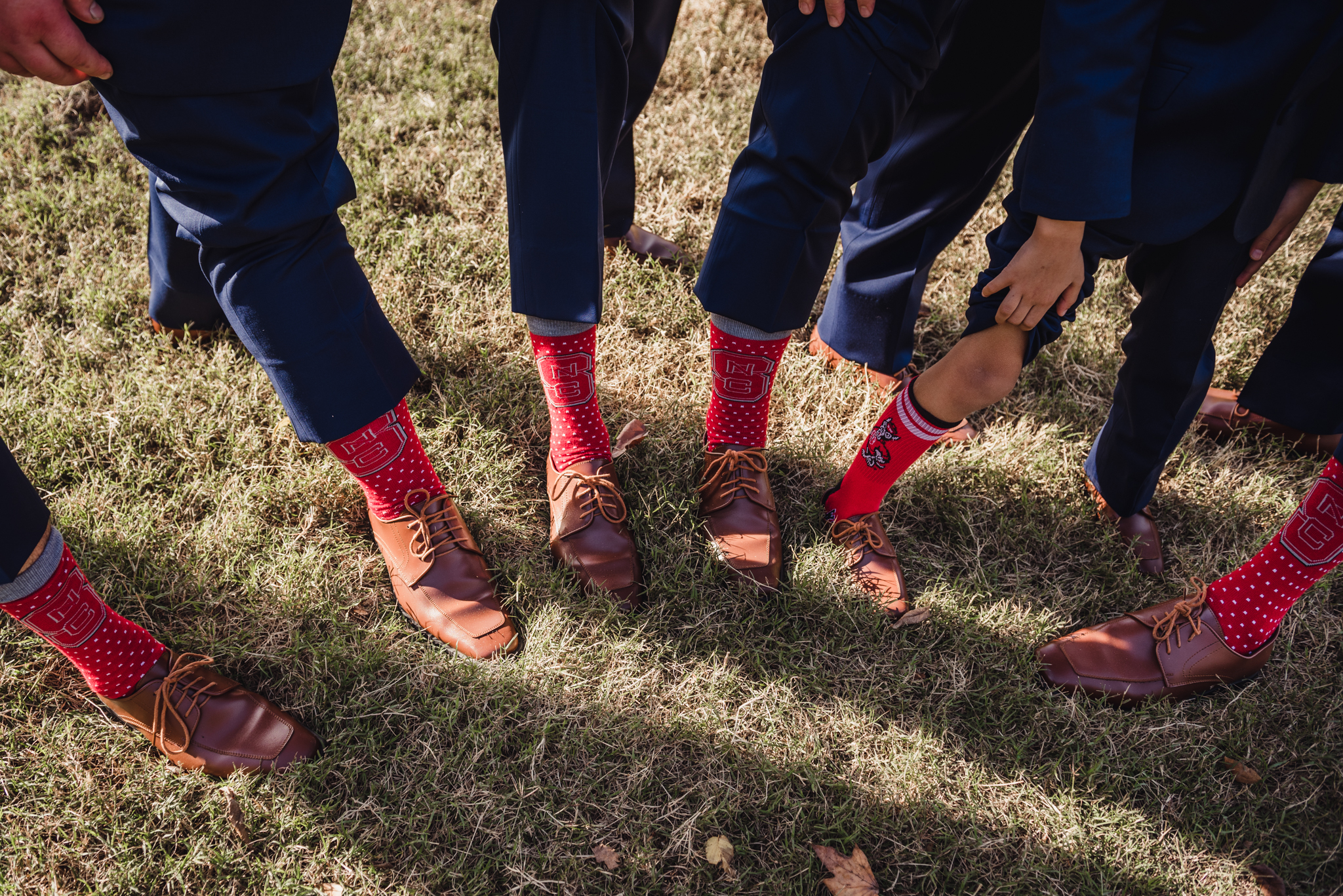 the-groomsmen-wearing-ncstate-wolfpack-socks.jpg