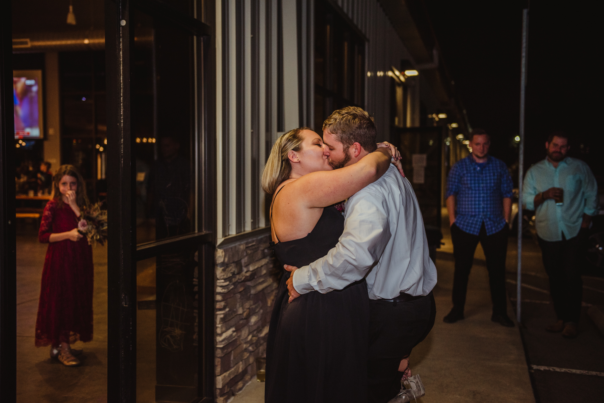 bride-and-groom-do-their-first-dance-outside-with-their-family-watching.jpg