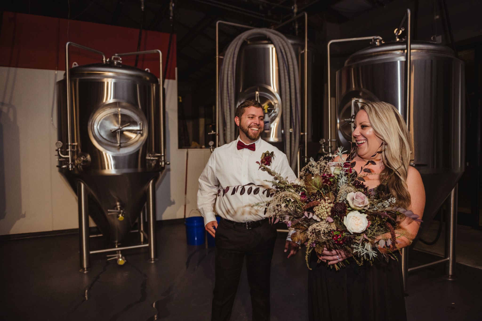 bride-and-groom-portraits-in-the-brewing-room-at-compass-rose.jpg