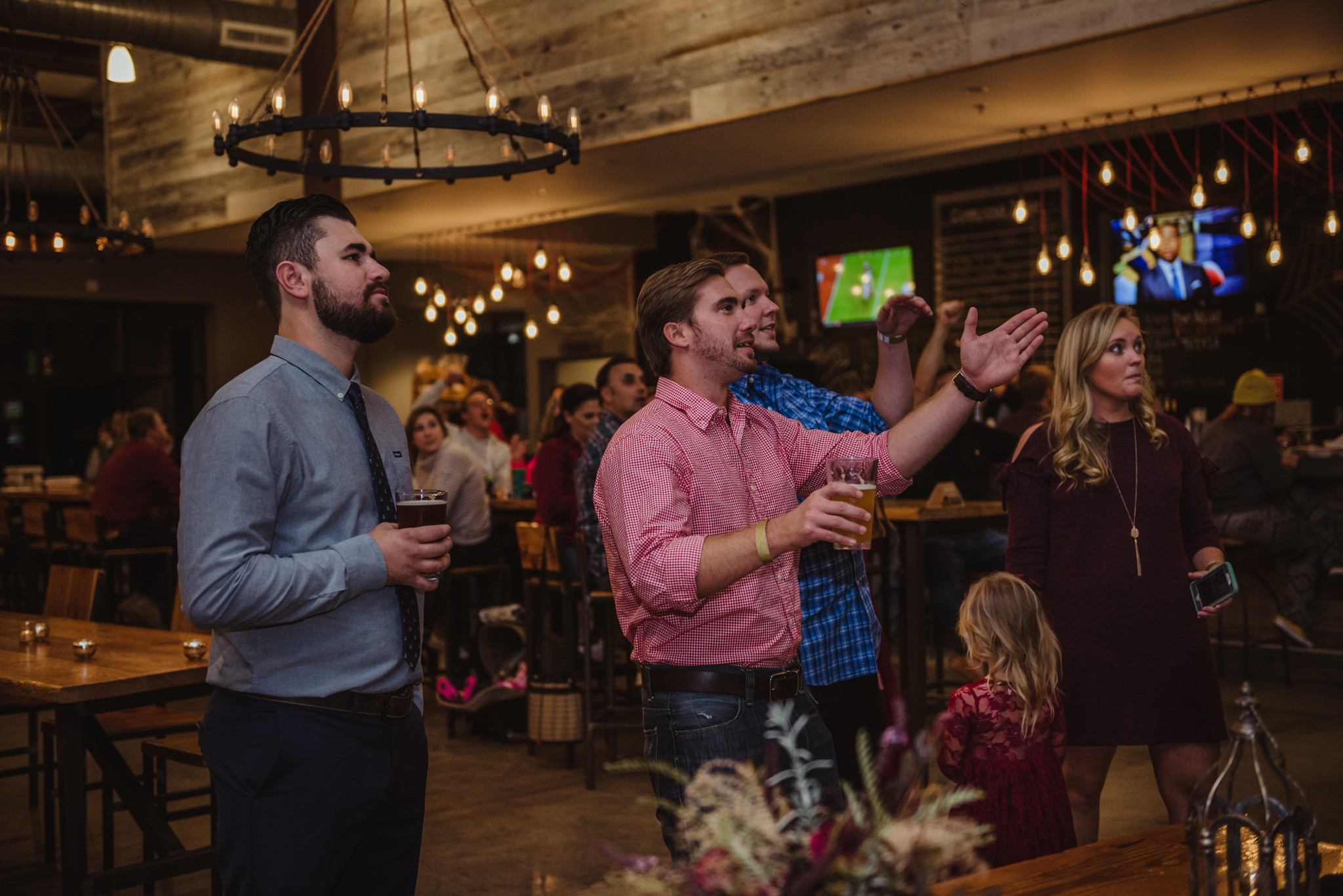 guests-at-the-brewery-cheering-for-ncstate-against-clemson-during-the-reception.jpg