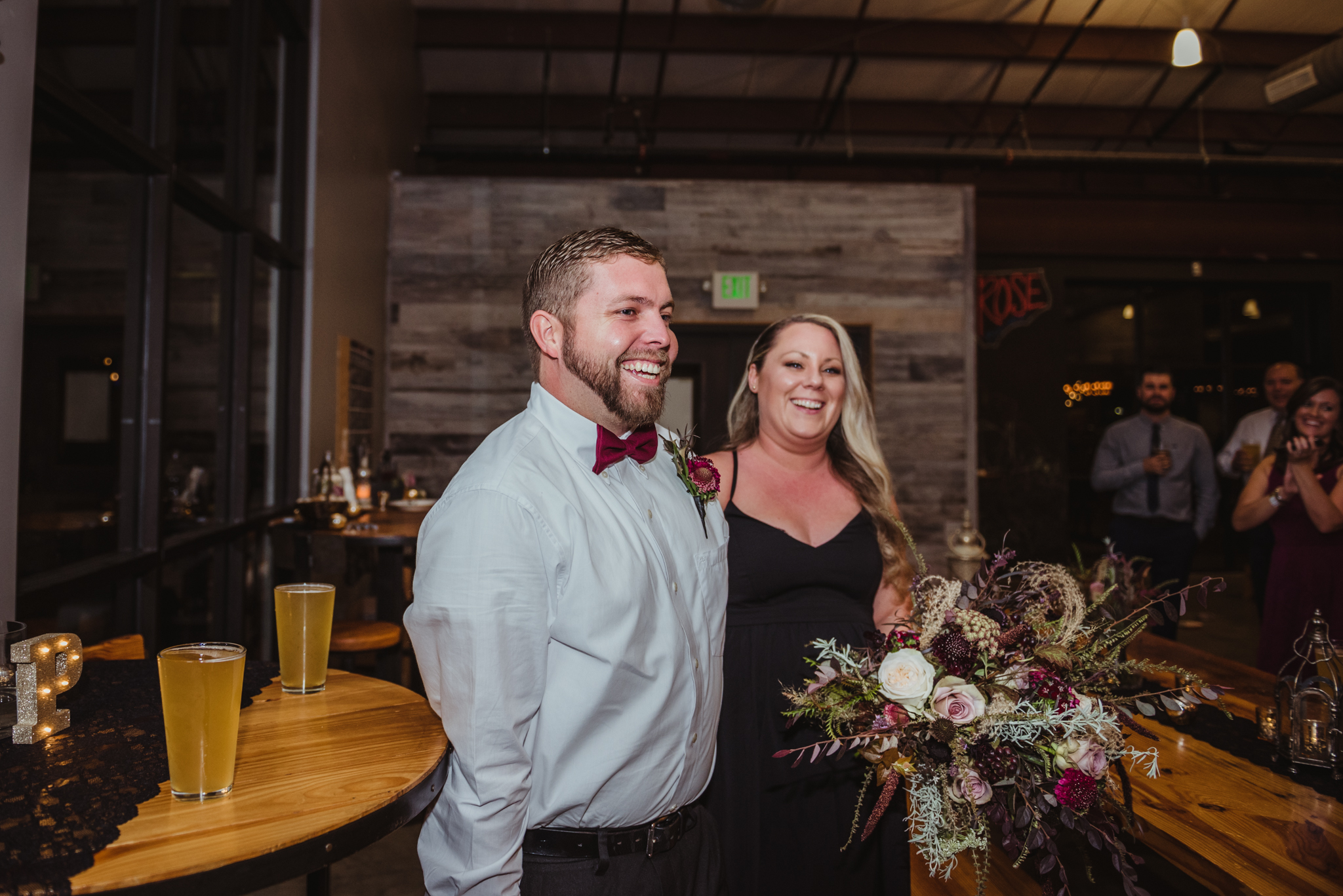 the-bride-and-groom-enter-the-brewrery-for-the-wedding-reception.jpg