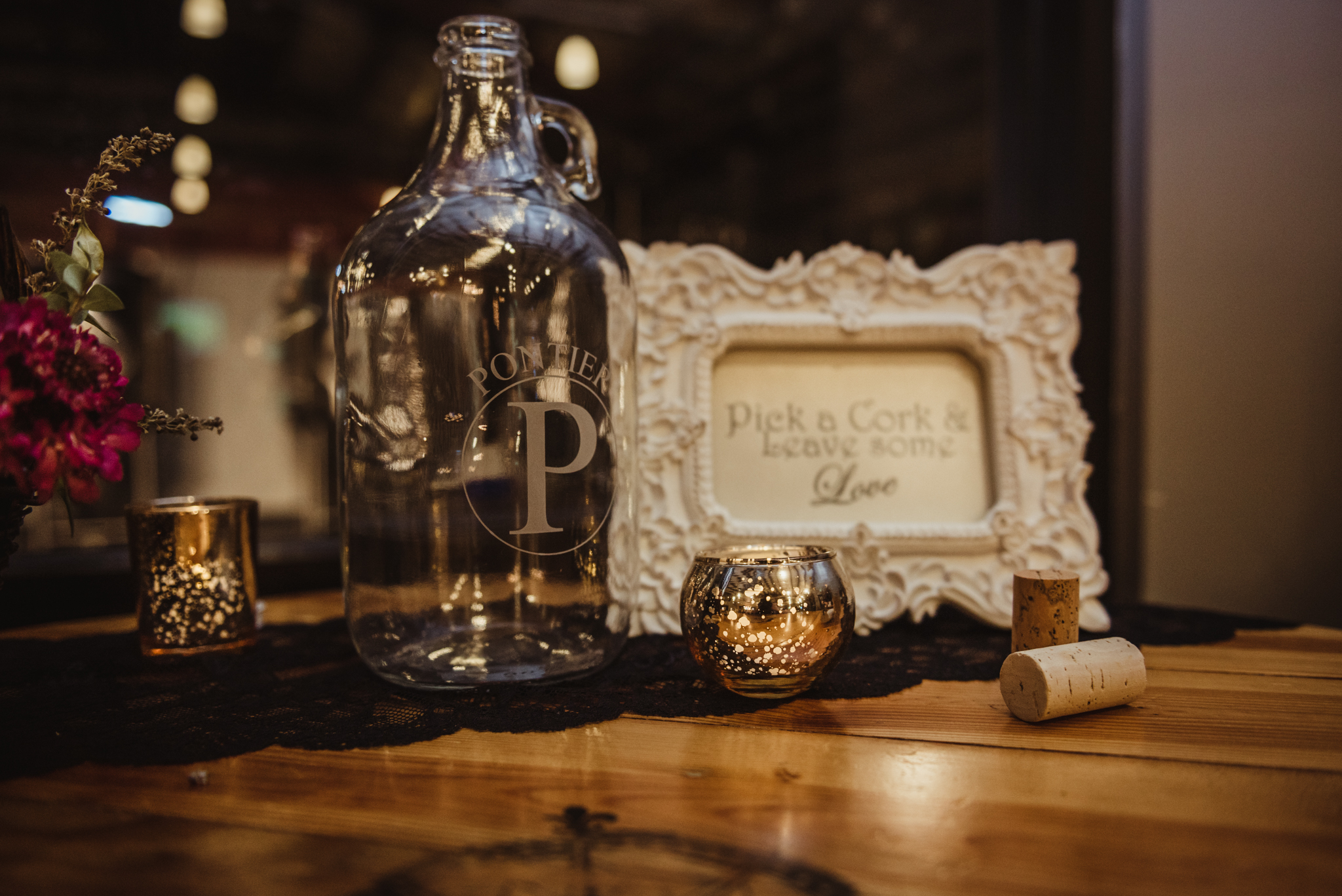 the-guests-write-well-wishes-on-corks-at-the-reception.jpg
