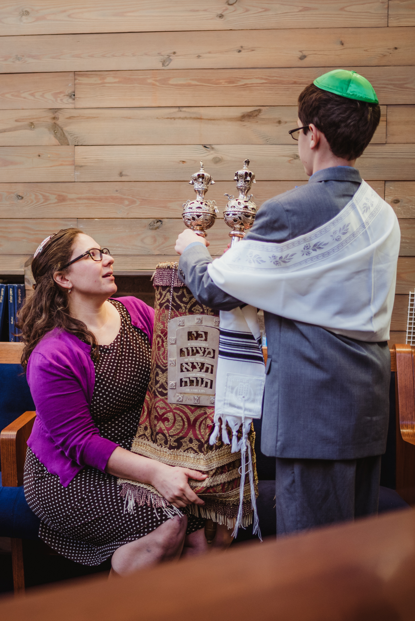 Getting-the-torah-prepared-for-the-ceremony-with-the-rabbi.jpg