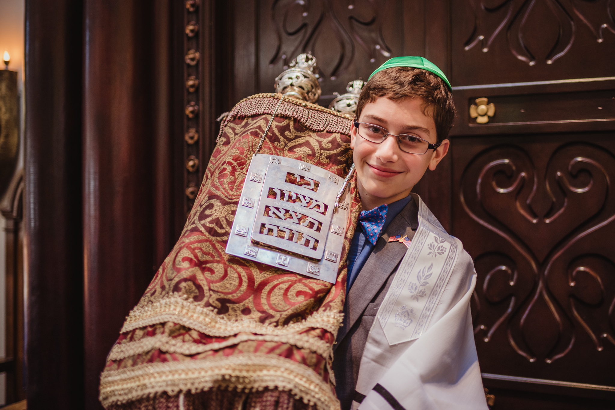 the-mitzvah-boy-posing-with-the-torah-in-front-of-the-ark-in-Temple-Beth-Or-in-Raleigh.jpg