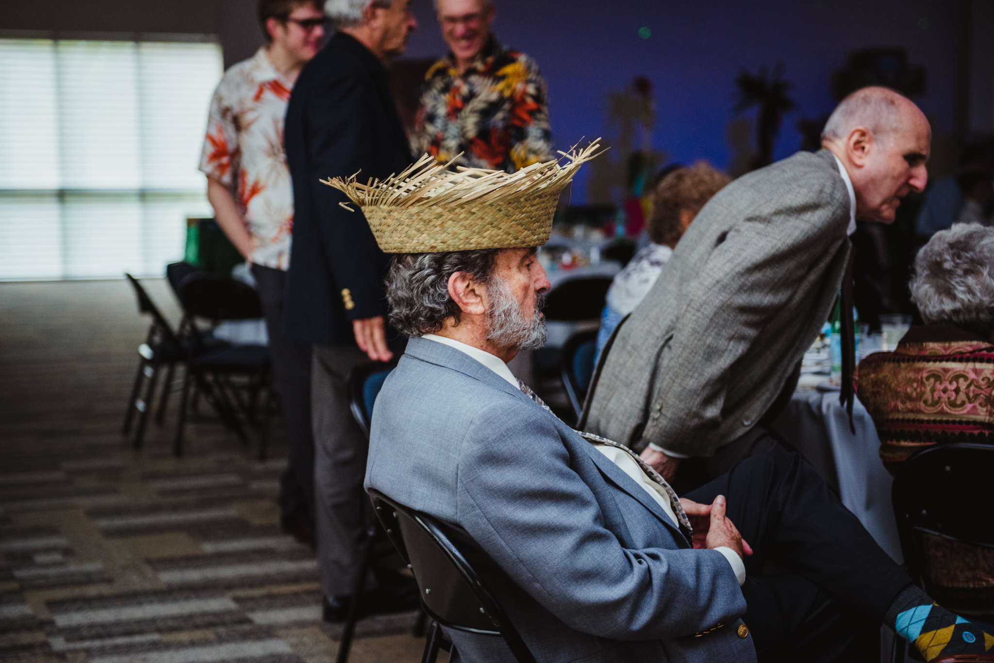 wearing-a-hula-hat-while-watching-the-dancing-at-the-mitzvah-celebration.jpg