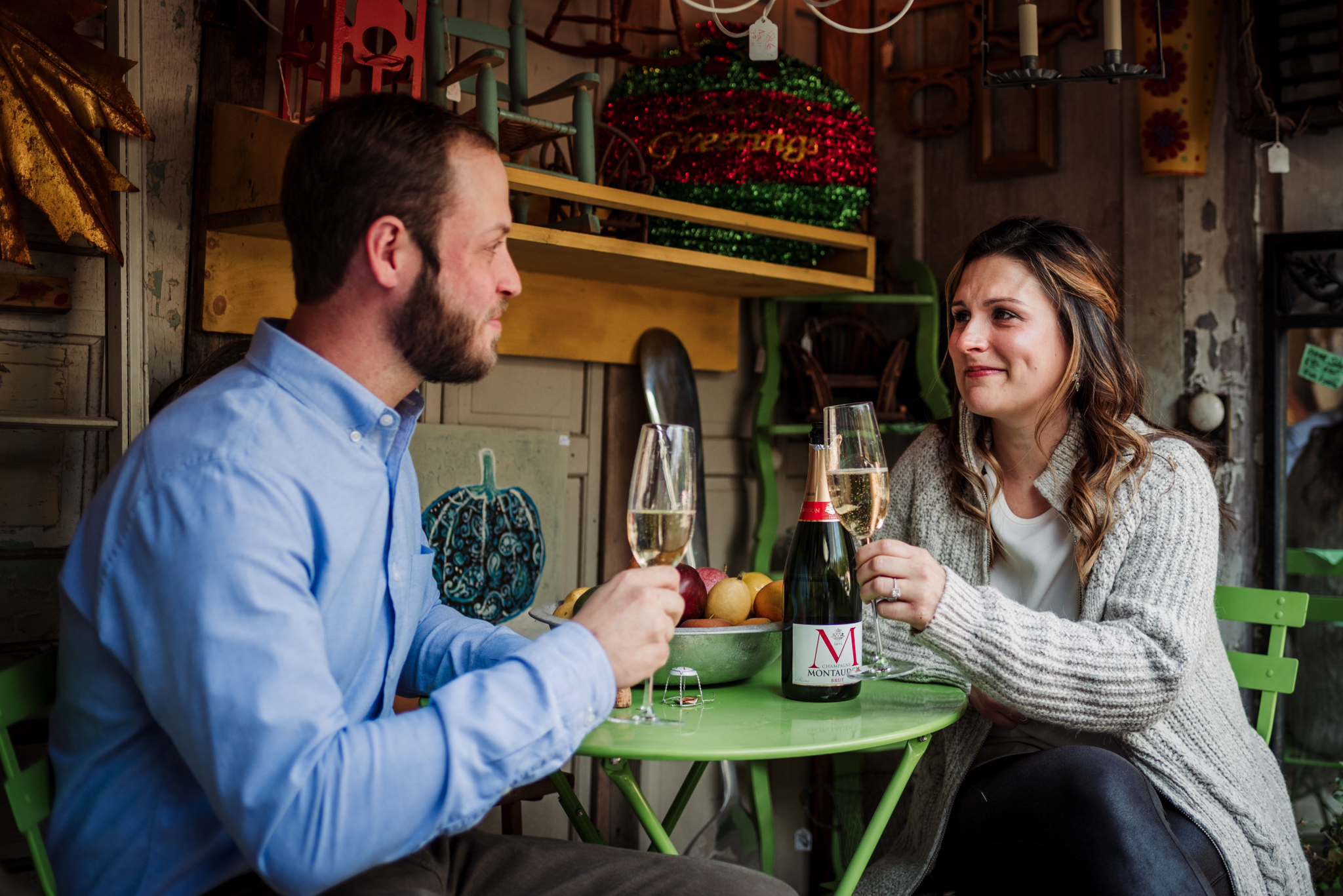 toasting-their-dating-anniversary-during-their-engagement-session.jpg