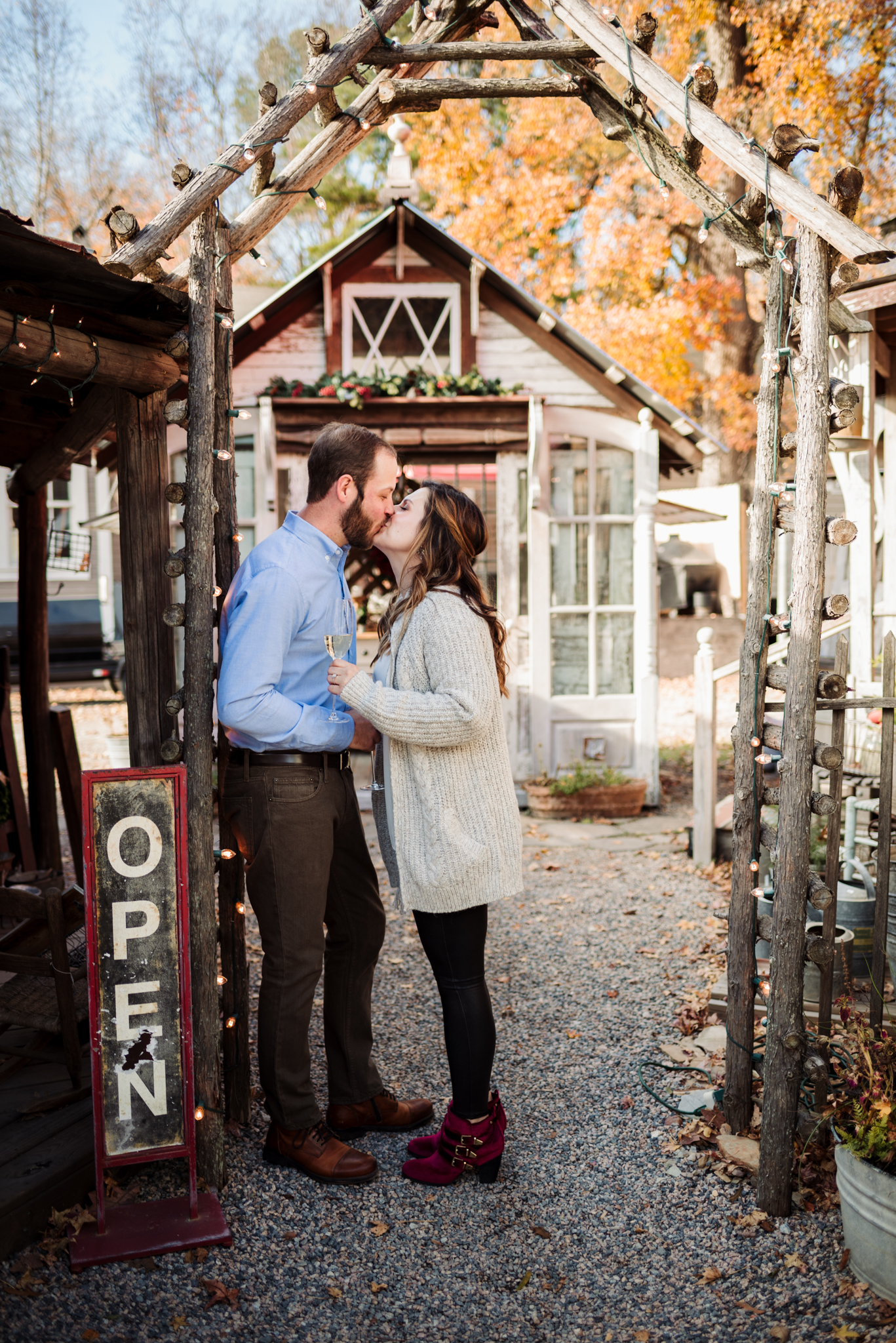 kissing-under-the-archway-during-their-Raleigh-engagement-session.jpg