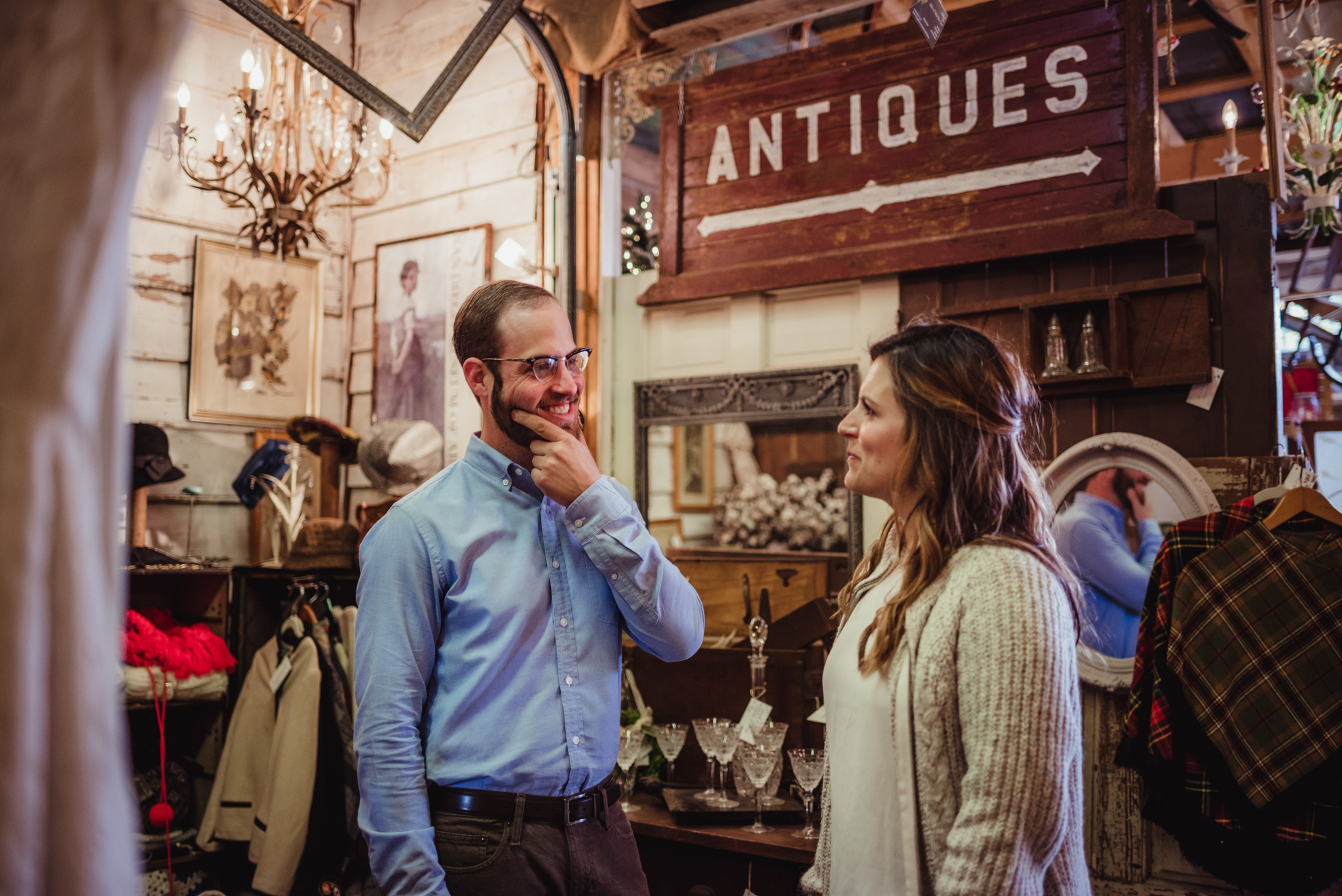 pondering-the-antiques-during-their-engagement-shoot.jpg