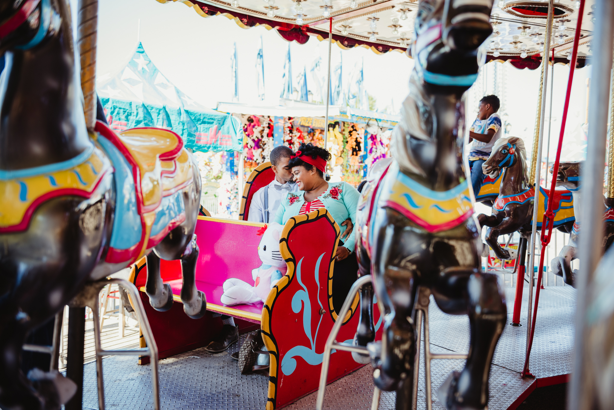 riding-the-carousel-with-hello-kitty-at-the-NC-State-fair.jpg