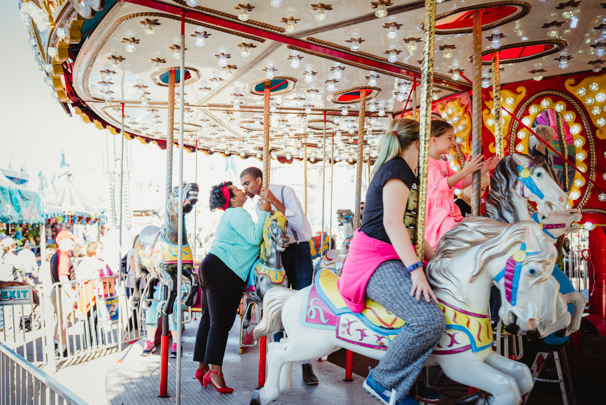 stealing-a-kiss-on-the-carousel-at-the-NC-State-fair.jpg