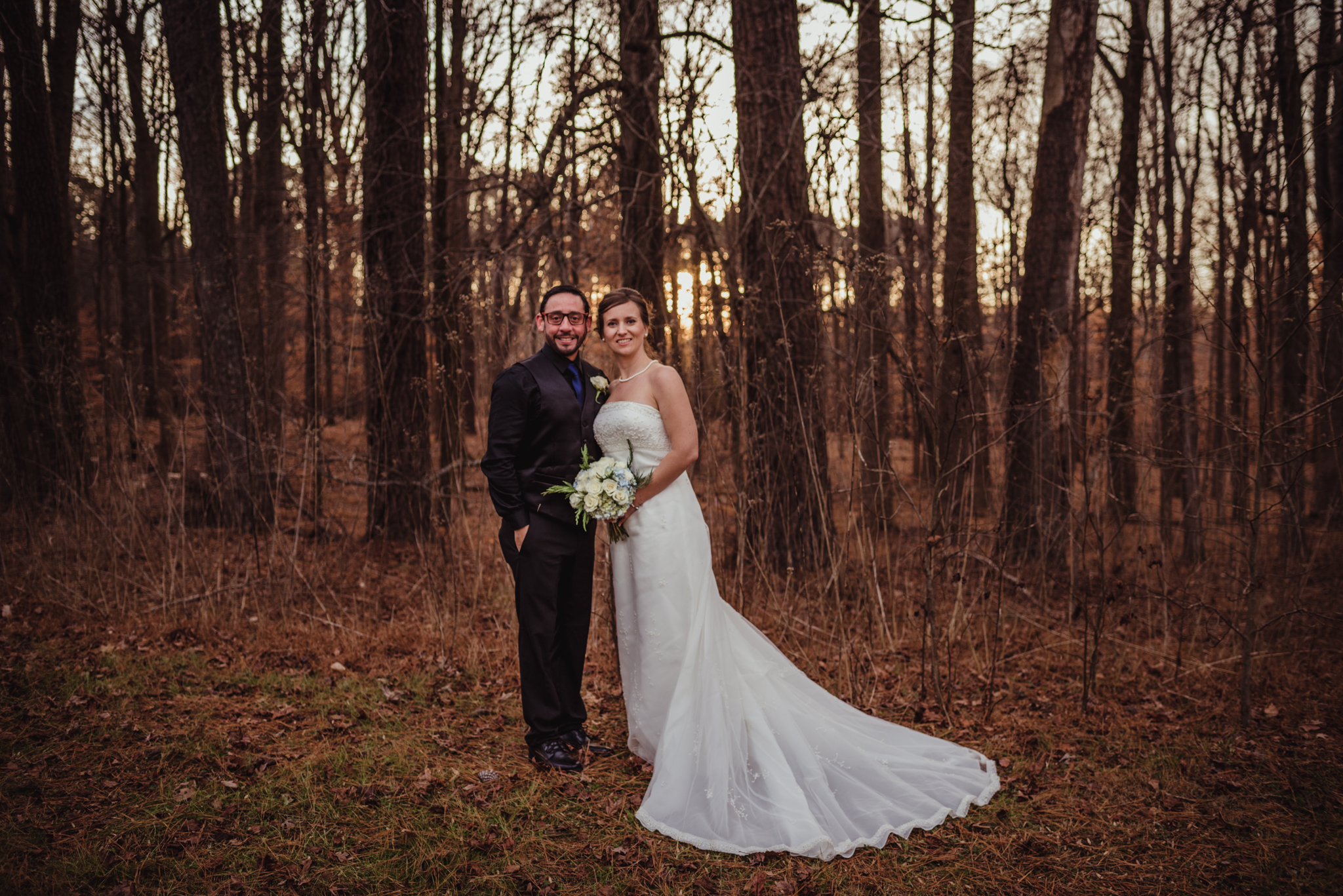 the-bride-and-groom-pose-for-pictures-in-the-woods-at-a-local-park-here-in-raleigh.jpg