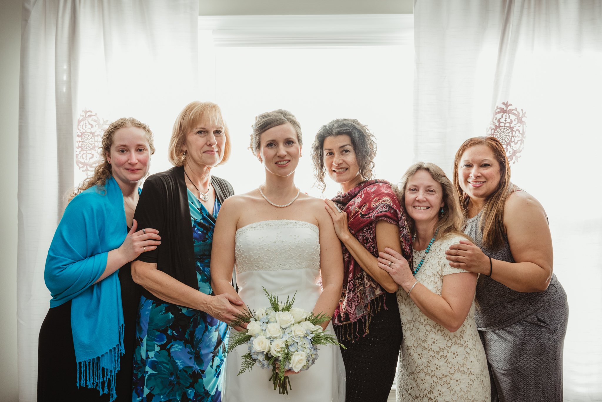 the-bride-tribe-before-she-walks-down-the-aisle-at-her-intimate-home-wedding-in-Raleigh.jpg
