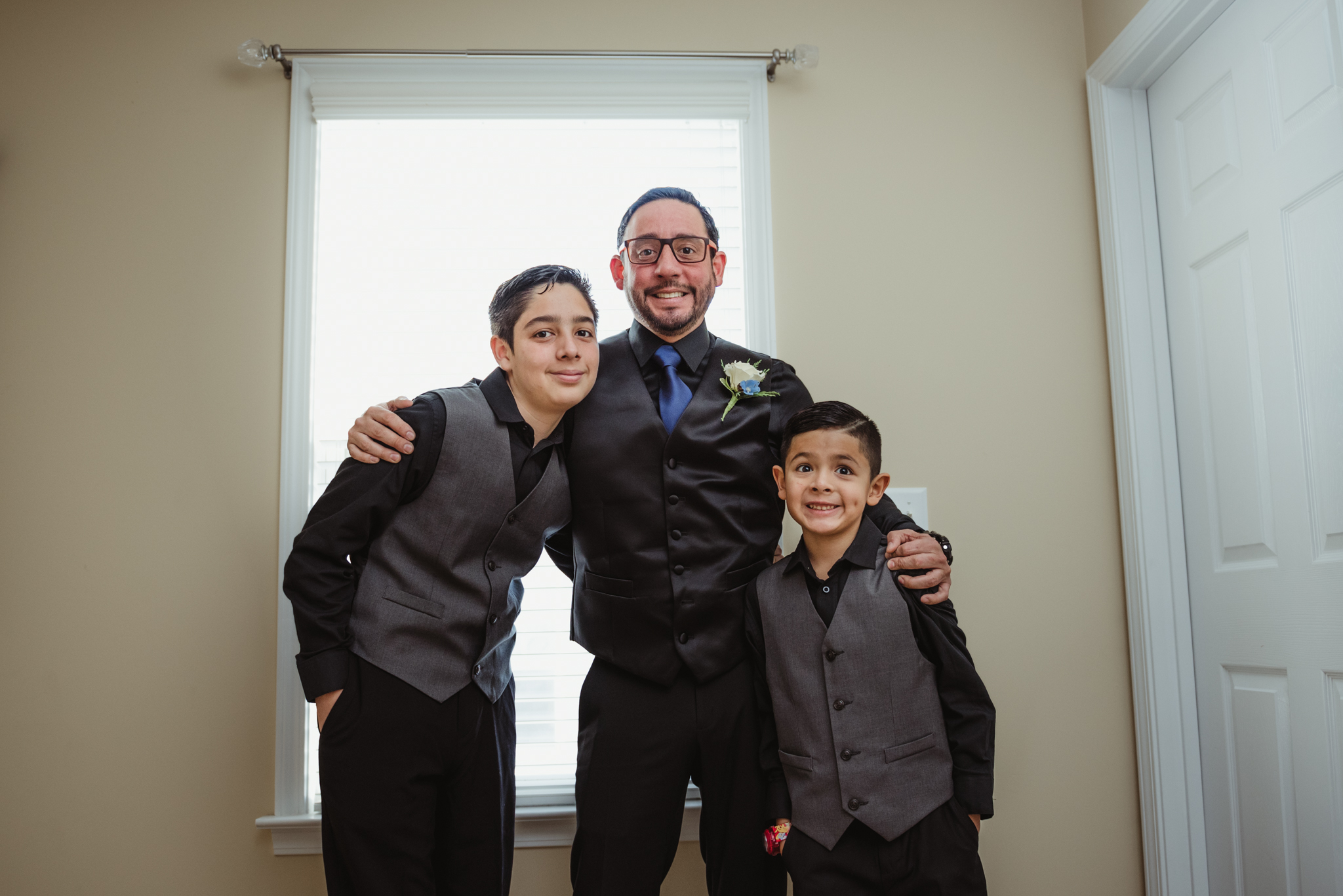 the-groom-and-his-sons-before-his-intimate-home-wedding-in-Raleigh.jpg