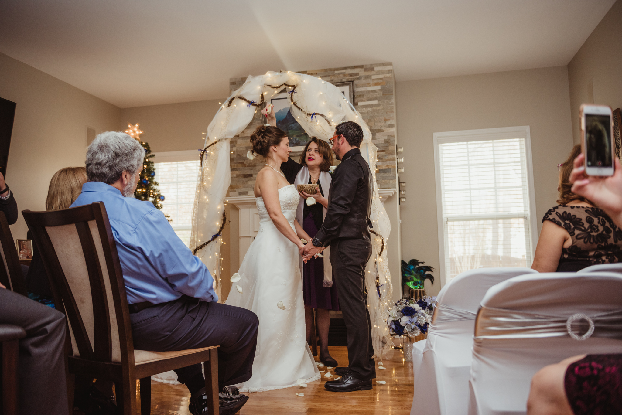 the-bride-and-groom-are-blessed-with-rose-petals-at-their-intimate-home-wedding-in-Raleigh.jpg