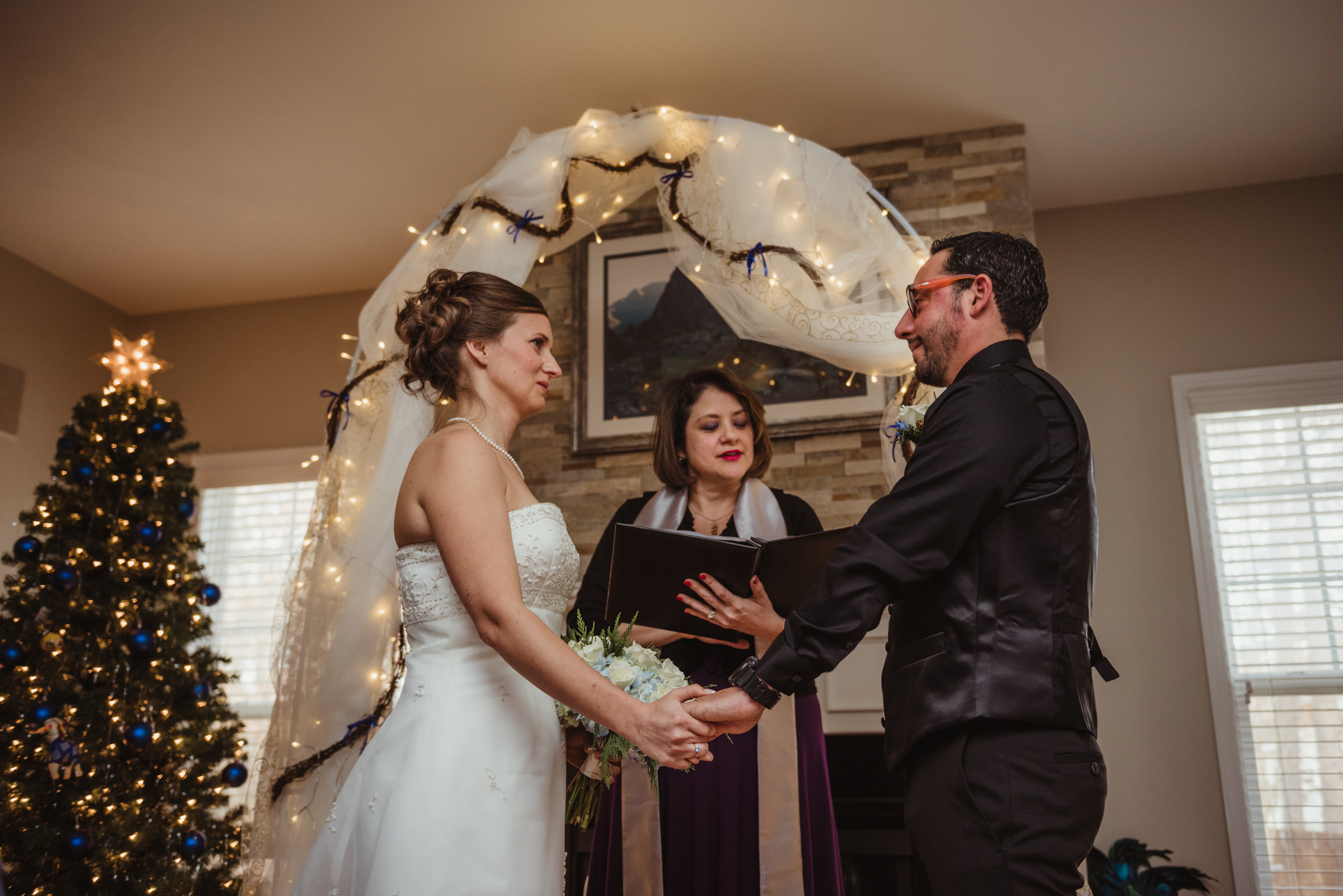 the-bride-and-groom-exchange-vows-at-their-intimate-home-wedding-in-Raleigh.jpg