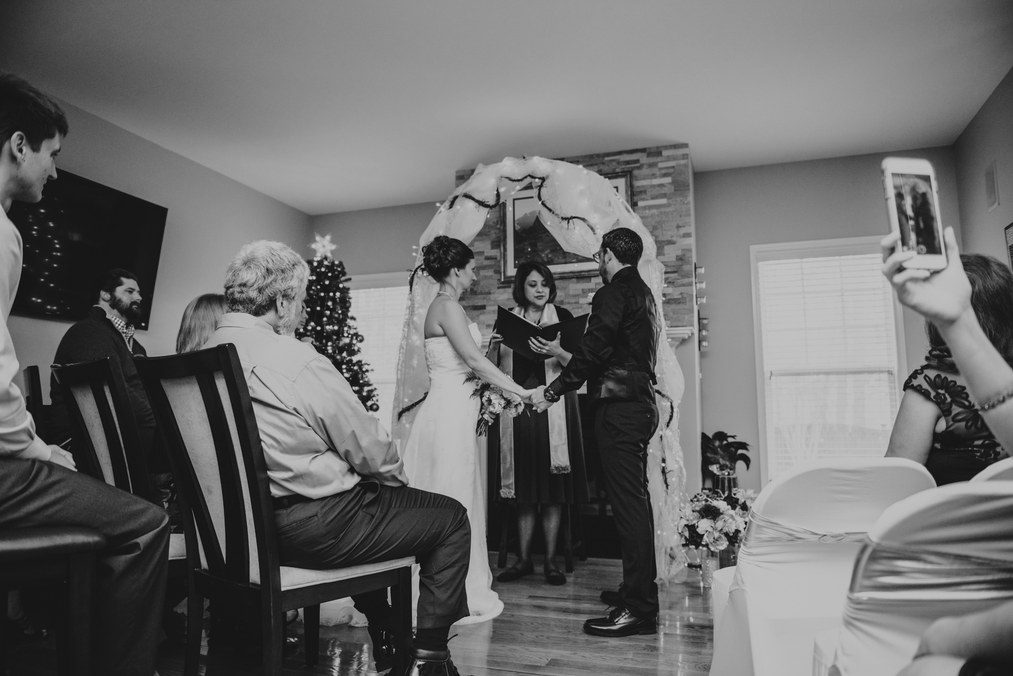 their-families-and-friends-watch-the-bride-and-groom-exchange-vows-at-their-intimate-home-wedding-in-Raleigh.jpg