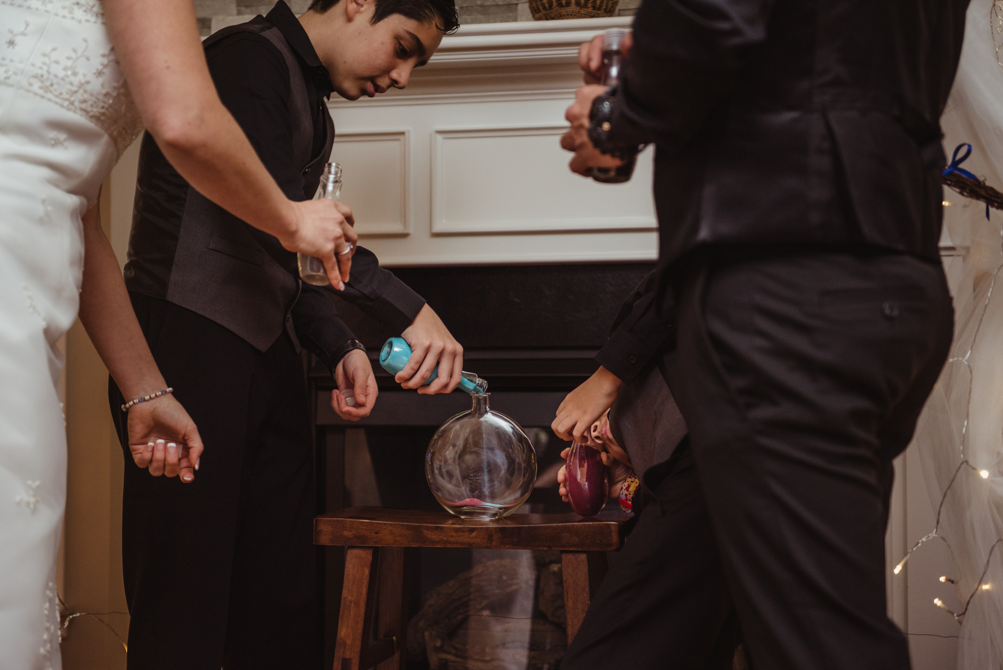 the-soon-to-be-family-of-four-have-a-sand-ceremony-at-their-intimate-home-wedding-in-Raleigh.jpg