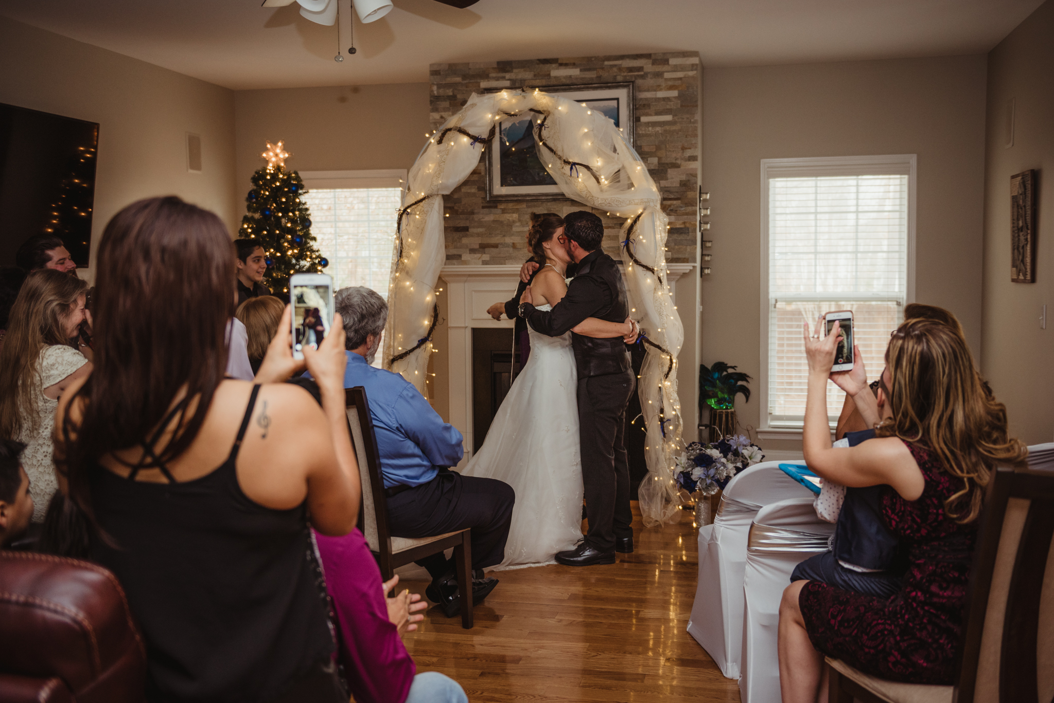 the-bride-and-groom-exchange-their-first-kiss-at-their-intimate-ceremony-at-their-home-in-Raleigh.jpg