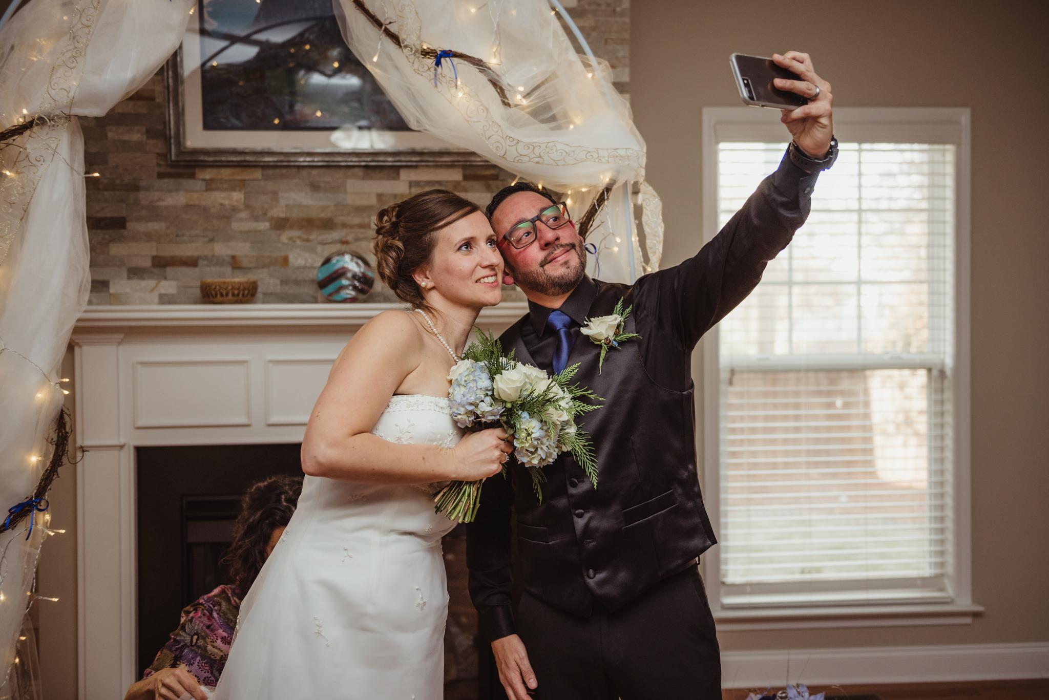 bride-and-groom-selfie-at-their-intimate-home-wedding-in-Raleigh.jpg