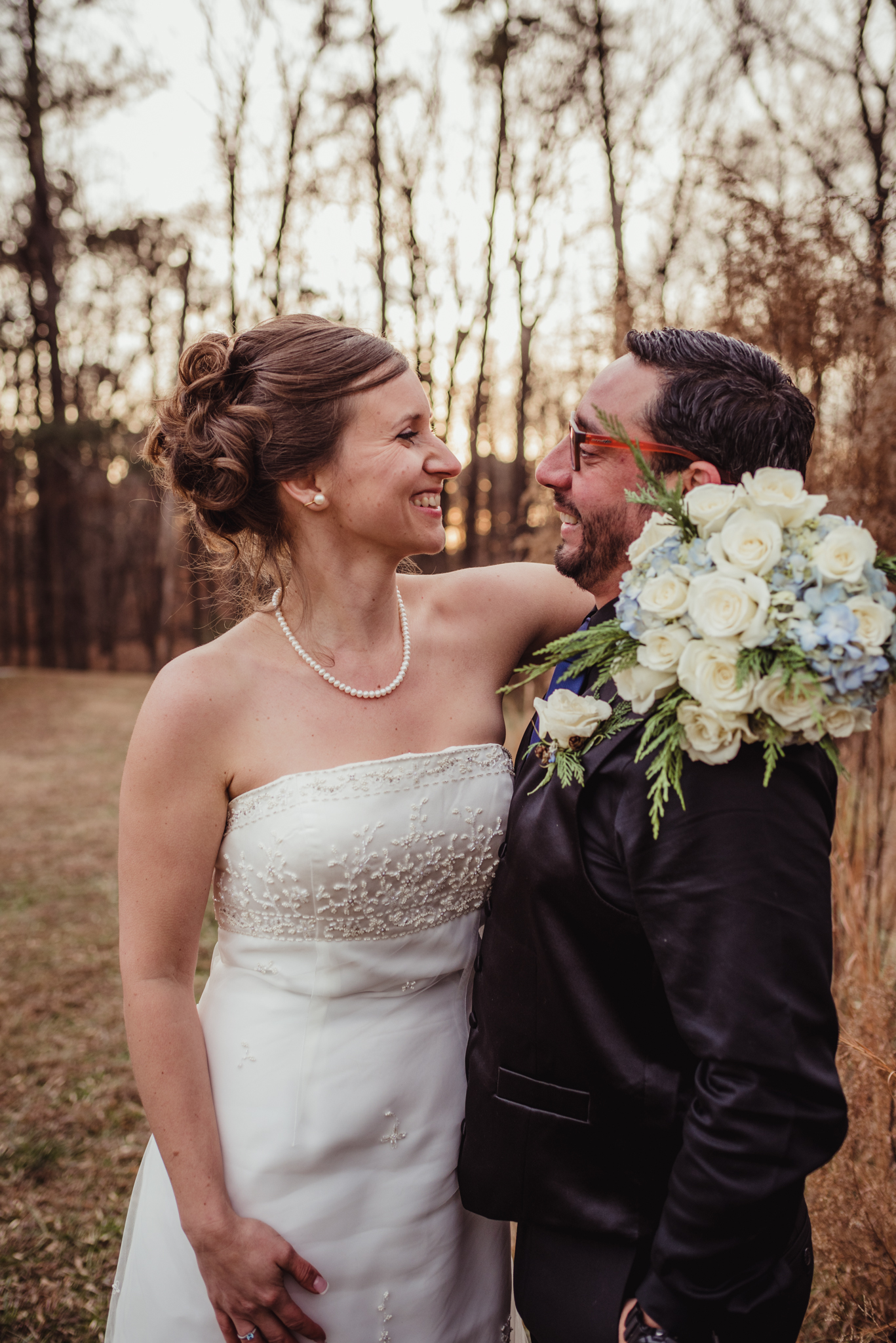 the-bride-and-groom-look-at-eachother-during-pictures-at-a-local-park-in-raleigh.jpg