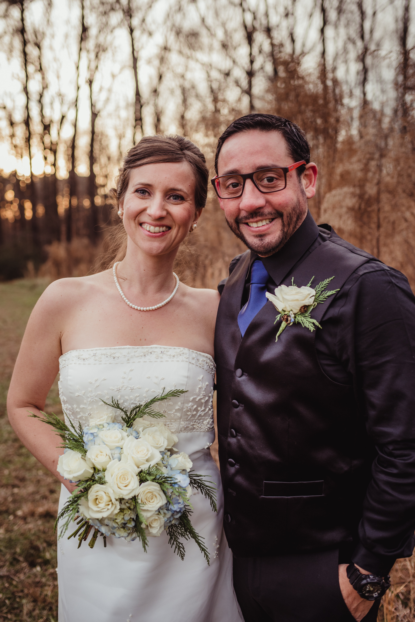 the-bride-and-groom-pose-for-pictures-at-a-local-park-here-in-raleigh.jpg