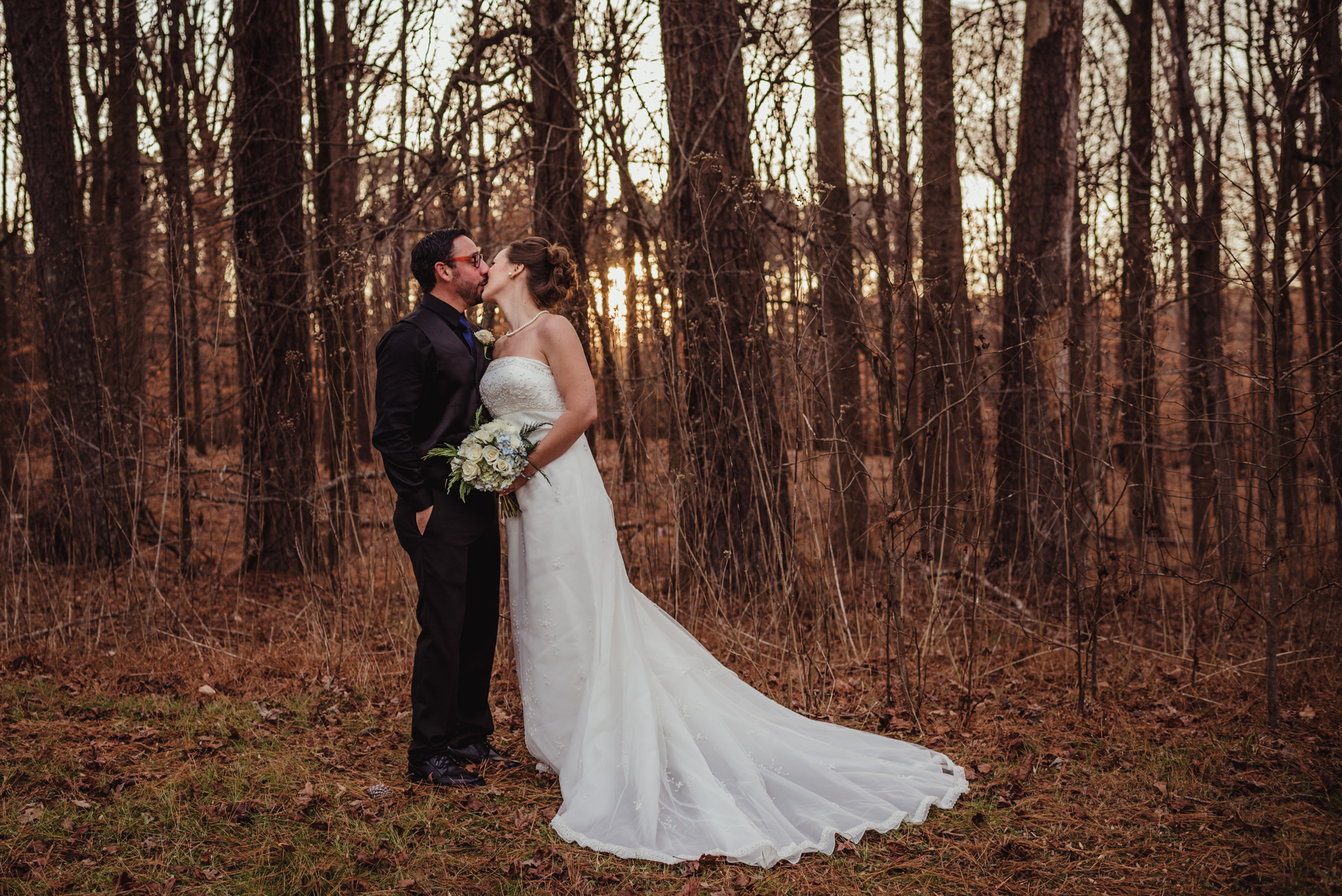 the-bride-and-groom-pose-for-a-kiss-at-a-local-park-here-in-raleigh.jpg