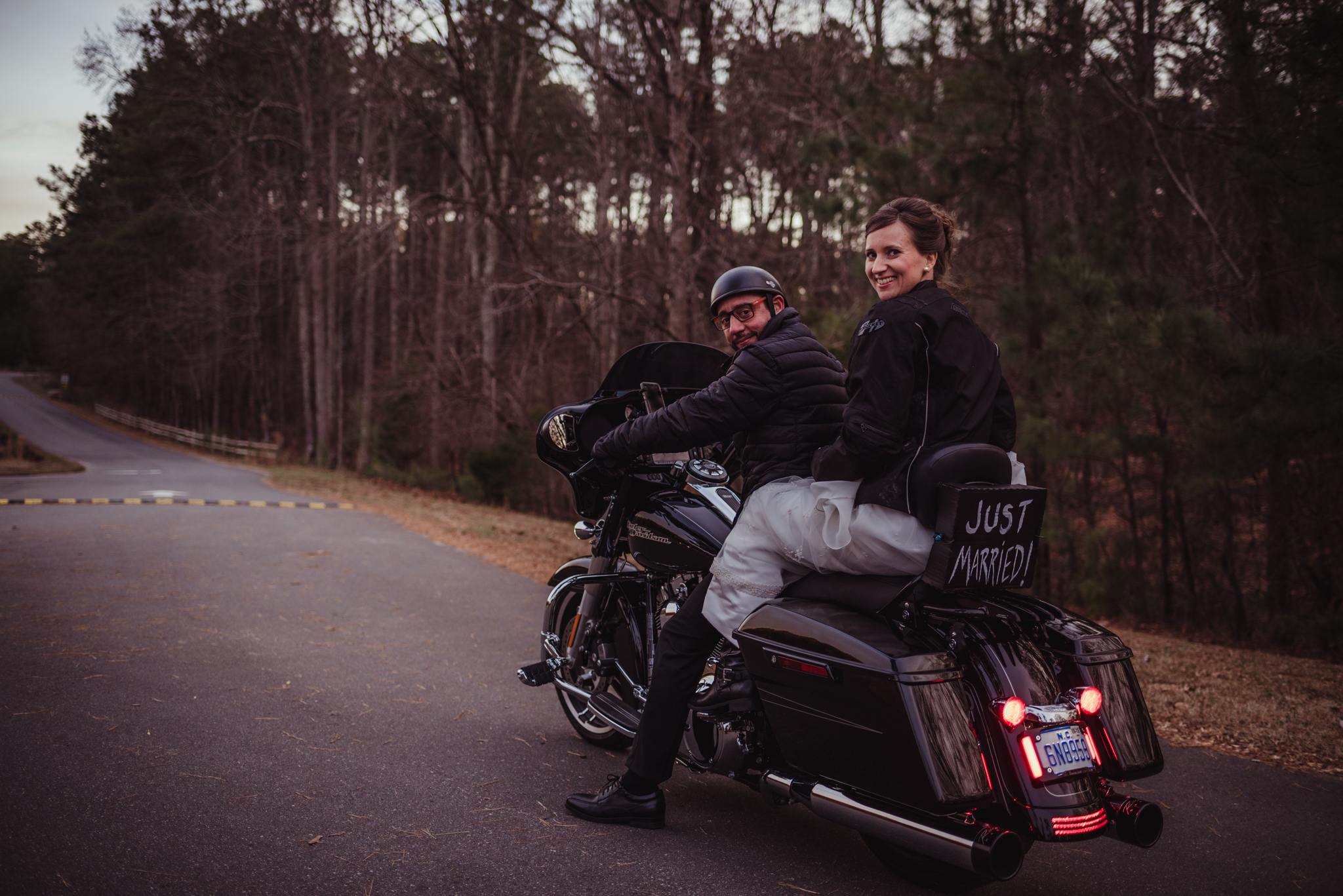 the-bride-and-groom-get-set-to-ride-off-on-their-motorcycle-after-getting-married-in-raleigh.jpg