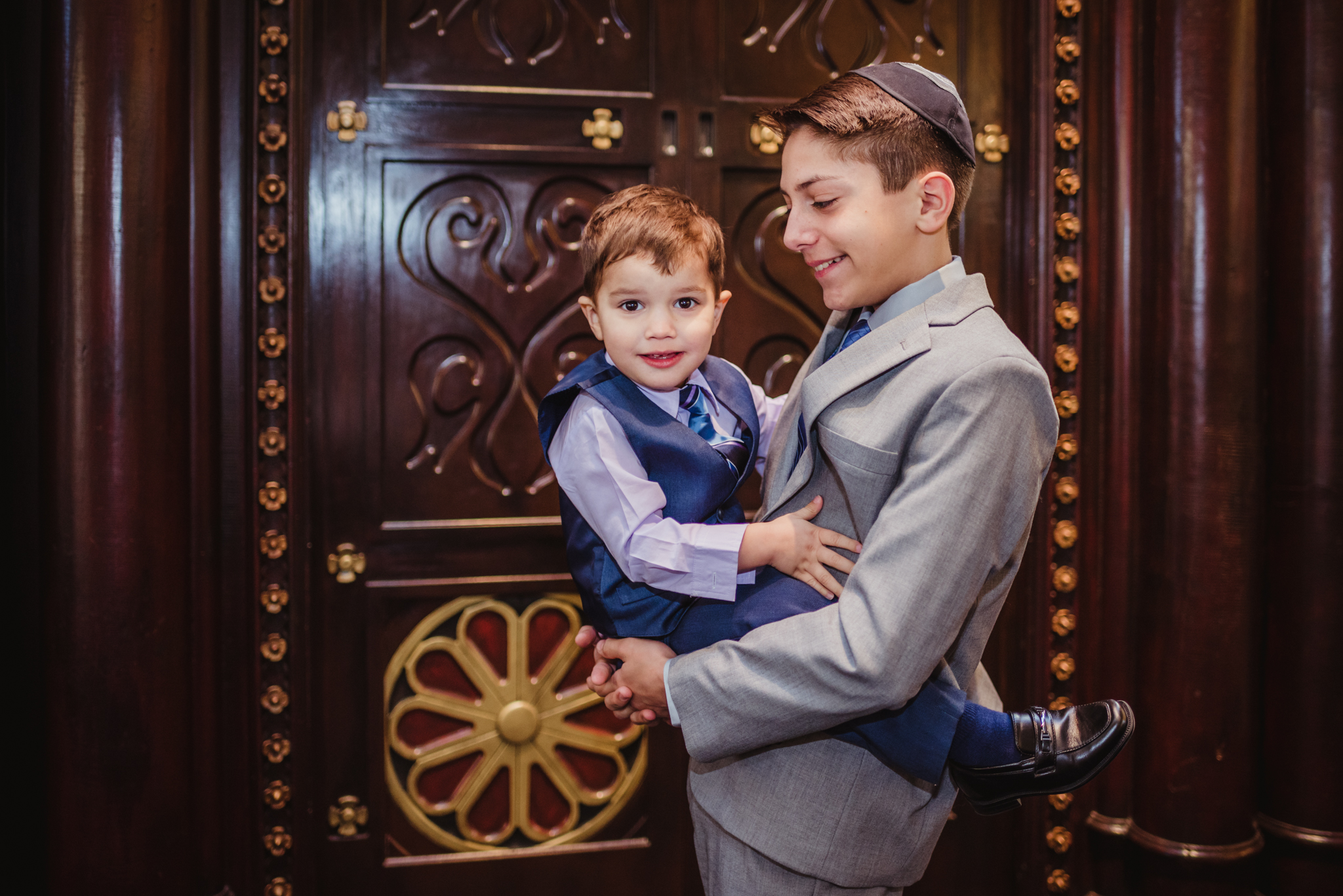 The bar mitzvah boy poses in front of the ark with his younger brother at Temple Beth Or in Raleigh.