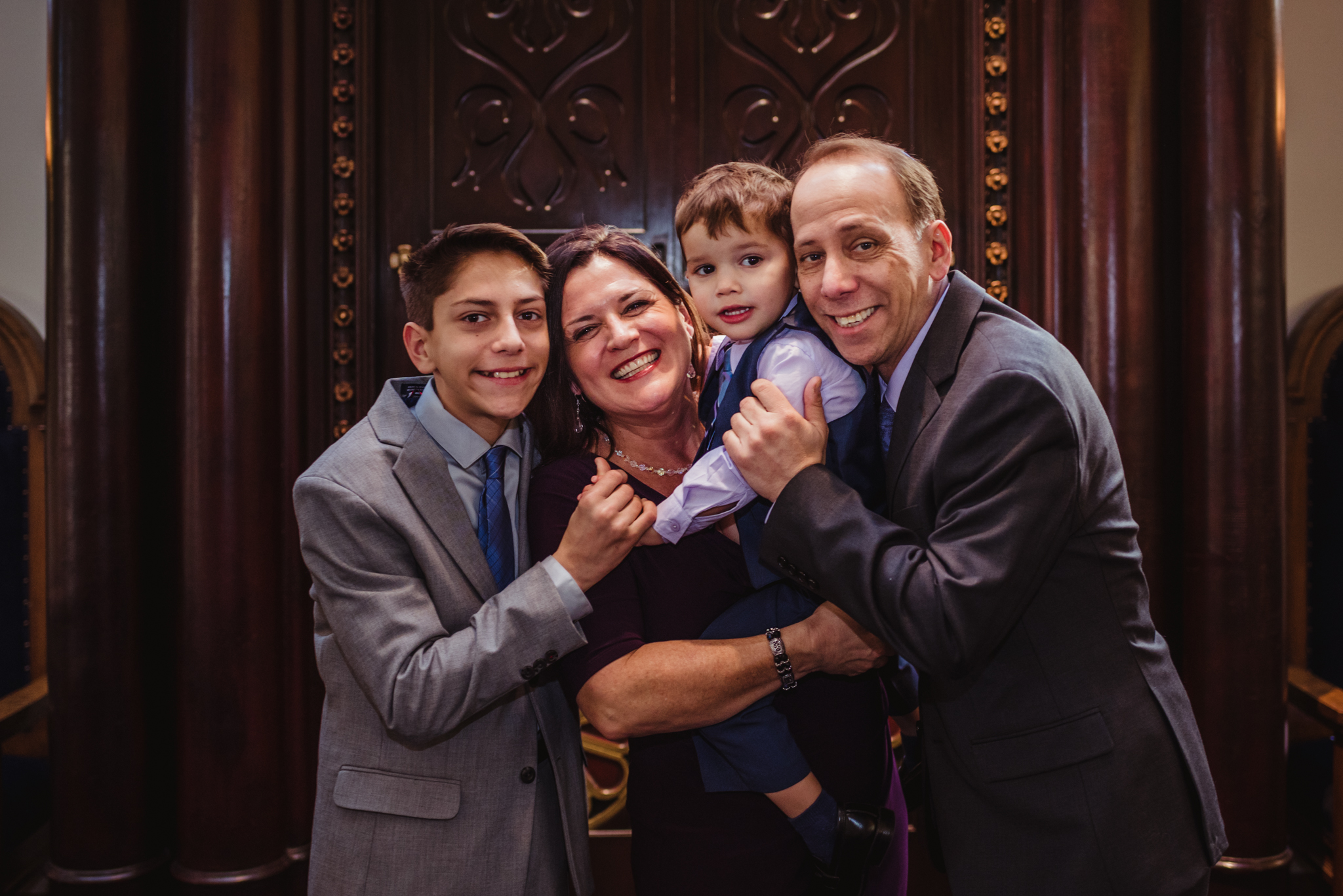 The family poses with their bar mitzvah boy at the ark at Temple Beth Or in Raleigh.