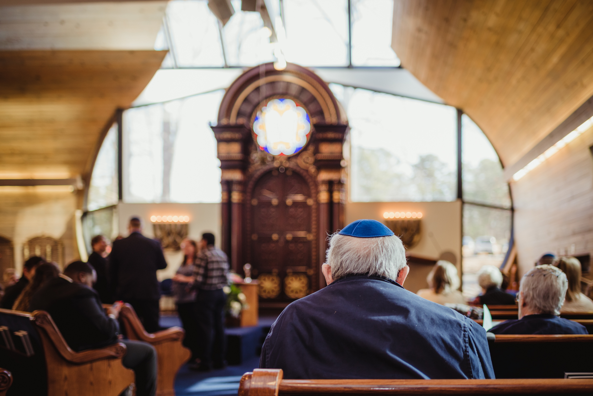 A man waits patiently in the sanctuary at Temple Beth Or while waiting for the bar mitzvah ceremony to begin.