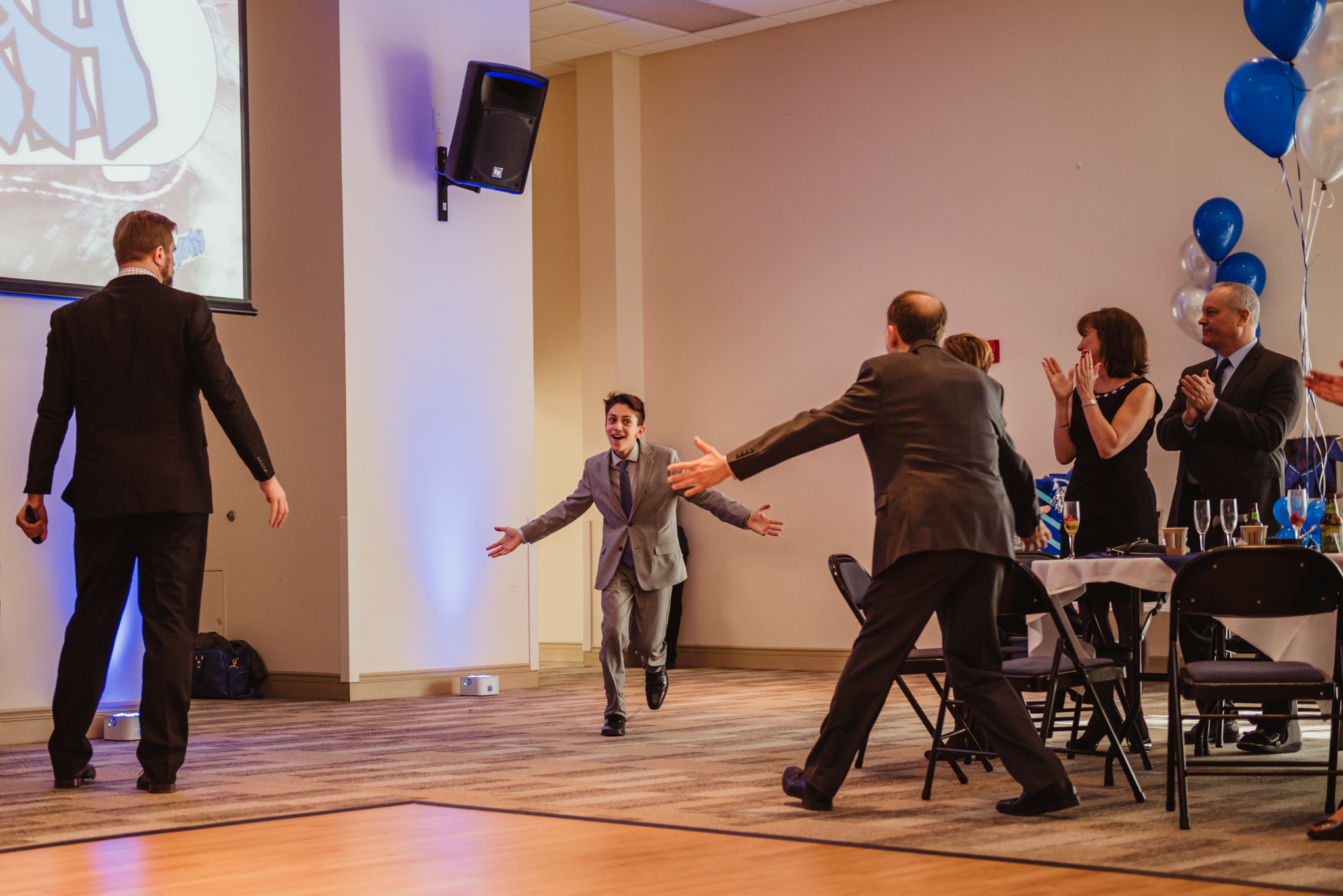 Noah makes his grand entrance into his bar mitzvah reception at Temple Beth Or in Raleigh.