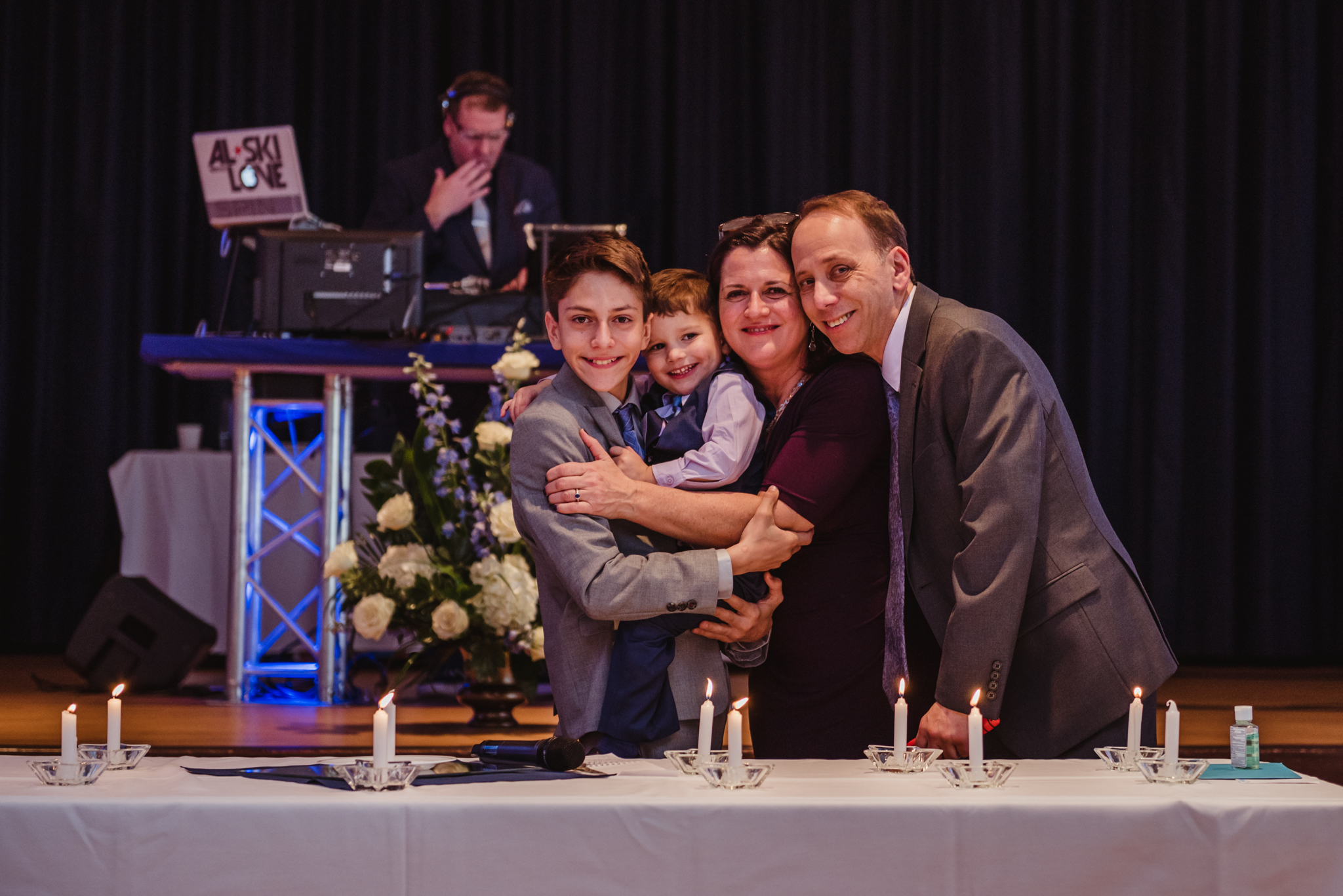 Noah and his family pose for a picture during the candle ceremony at his mitzvah reception at Temple Beth Or.