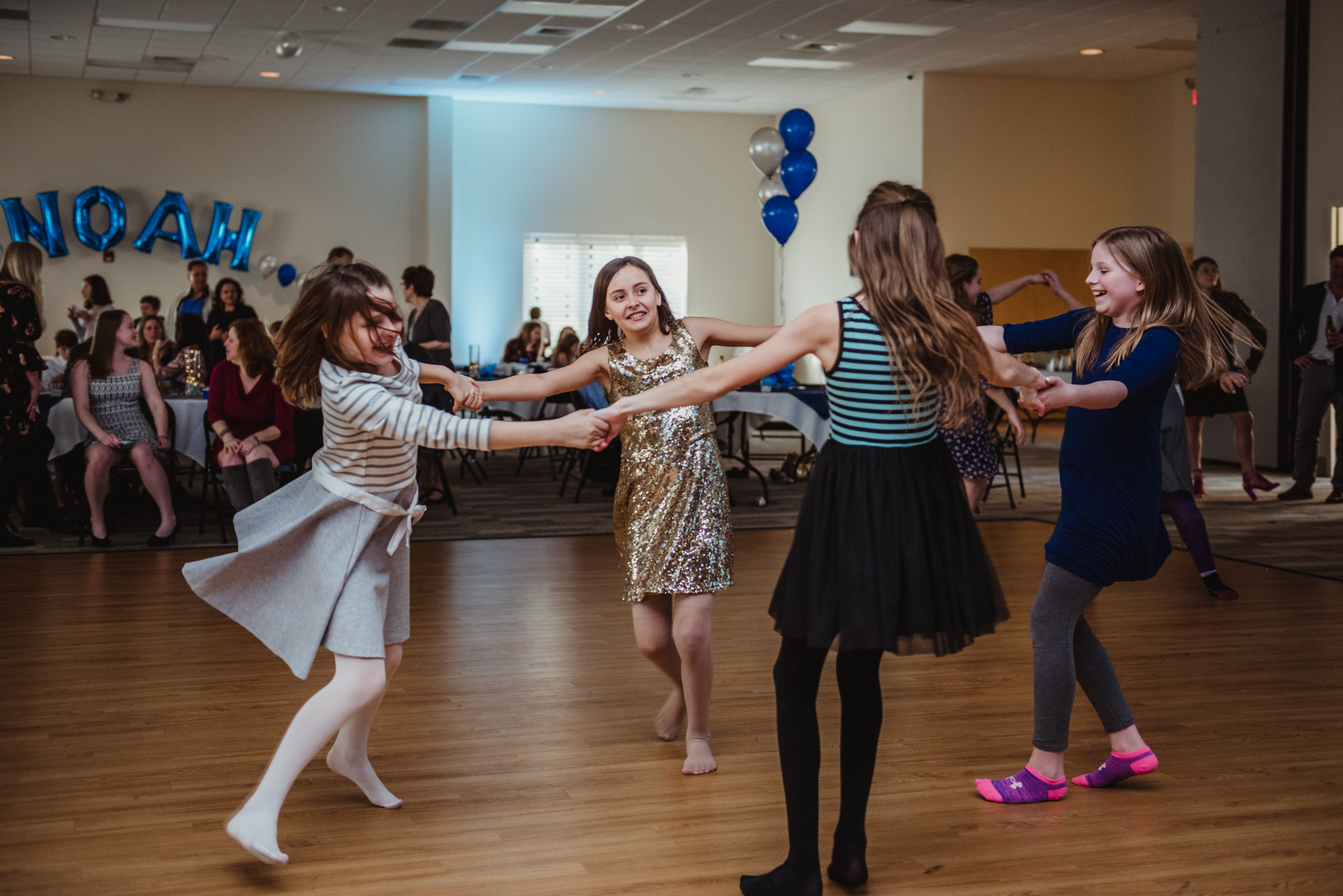 Girls dance together in a circle during the bar mitzvah reception at Temple Beth Or in Raleigh.