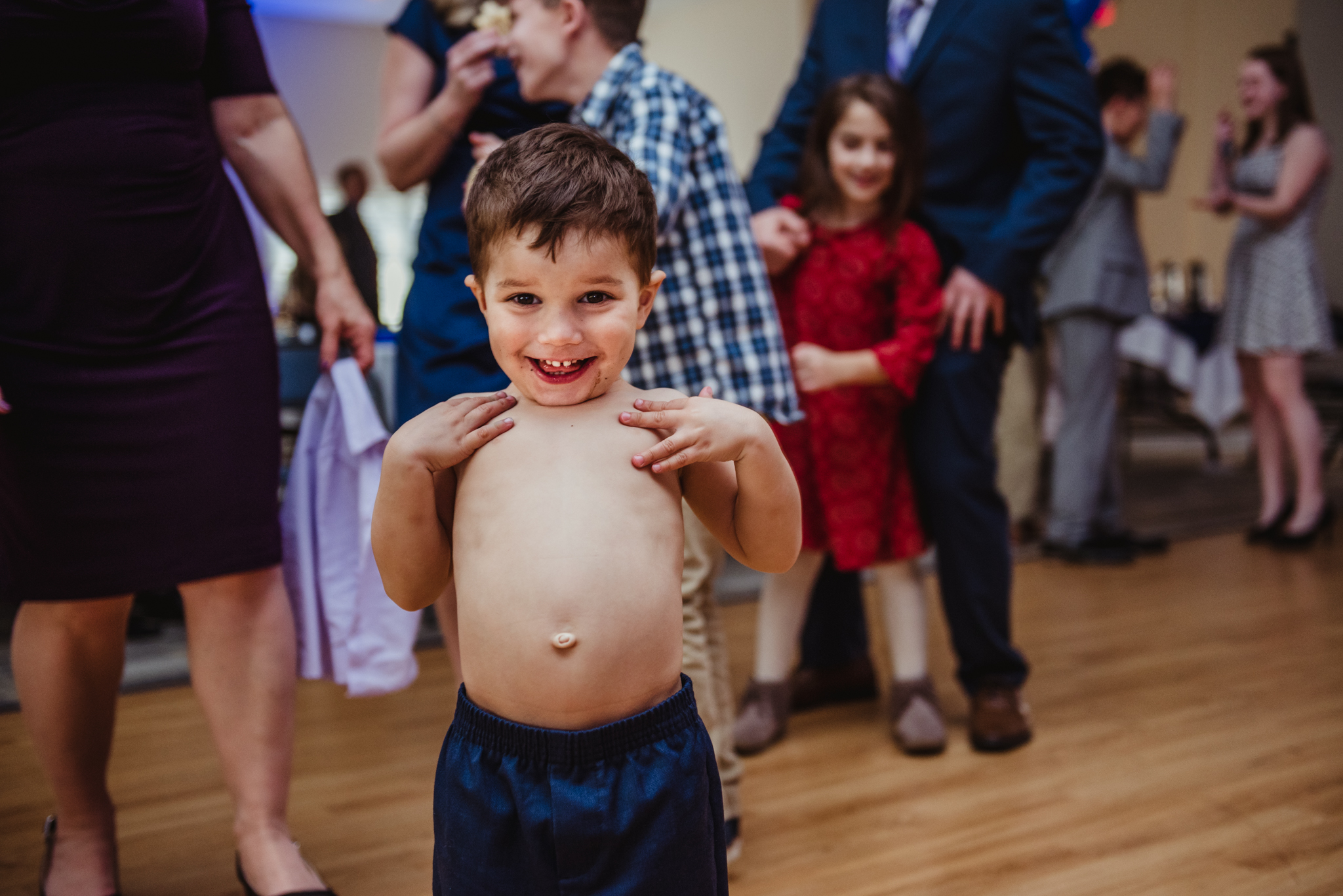 The four year old decided to take his shirt off and proudly show his belly button to the camera at the mitzvah reception.