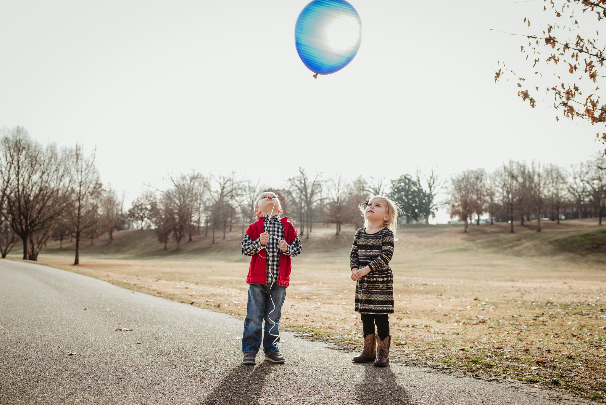"""""""We love you baby Wyatt"""" the three year old twins say as they hold onto the blue balloon, brought in his memory."""