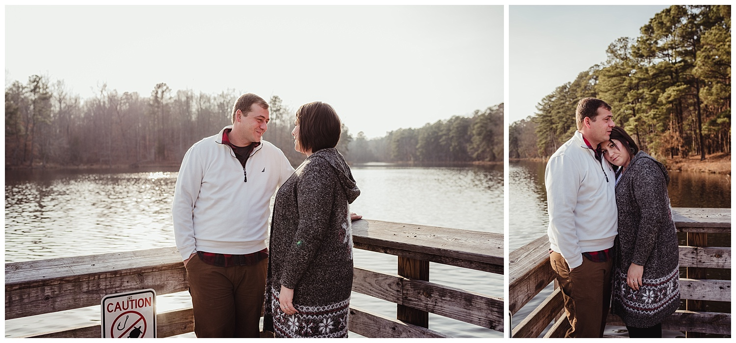 The couple snuggle on the dock at Durant Nature Park in Raleigh for their engagement pictures with Rose Trail Images.