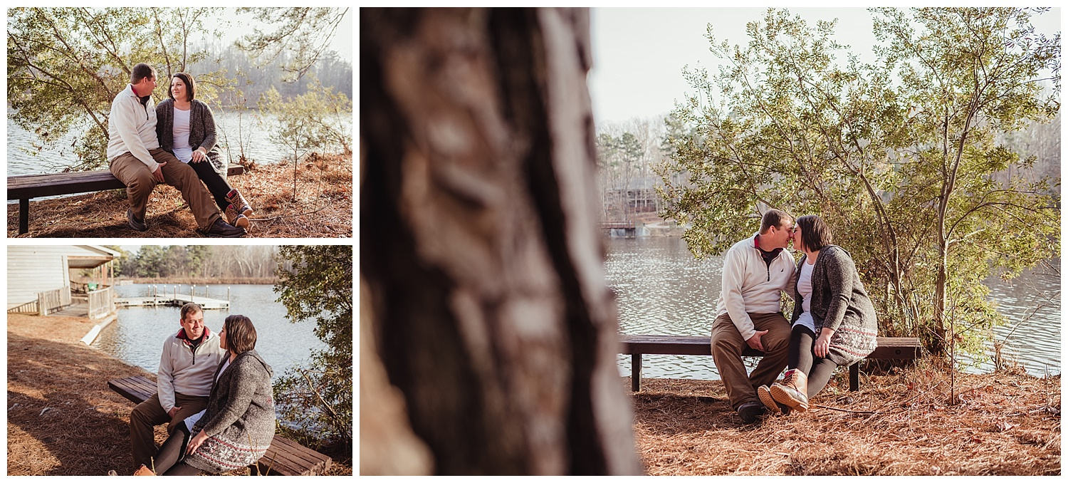 The couple sit on a bench near the lake at Durant Nature Park in Raleigh for their engagement pictures with Rose Trail Images.