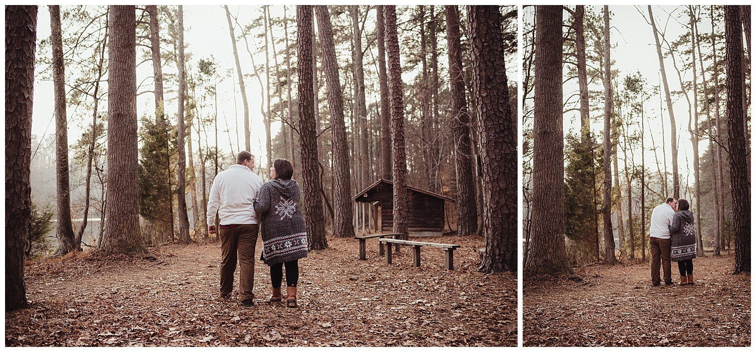 The engaged couple take a walk in the woods together at Durant Nature Park in Raleigh during their engagement session with Rose Trail Images.
