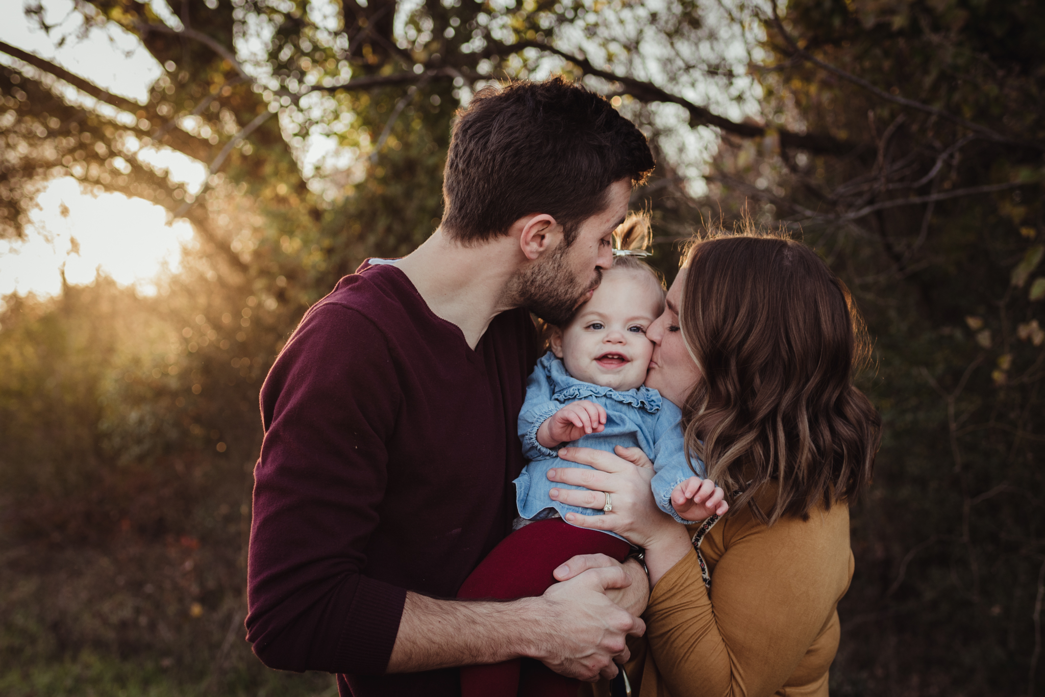 This young family of three kisses their young daughter at sunset during their family session with Rose Trail Images in Wake Forest, NC.