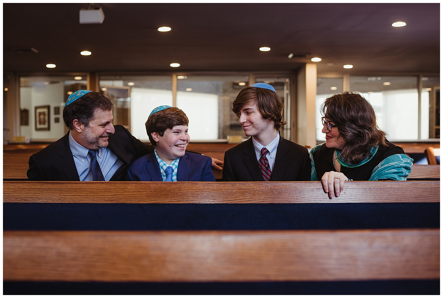 The family sits at the pew before their son becomes bar mitzvah at Temple Beth Or in Raleigh, NC.