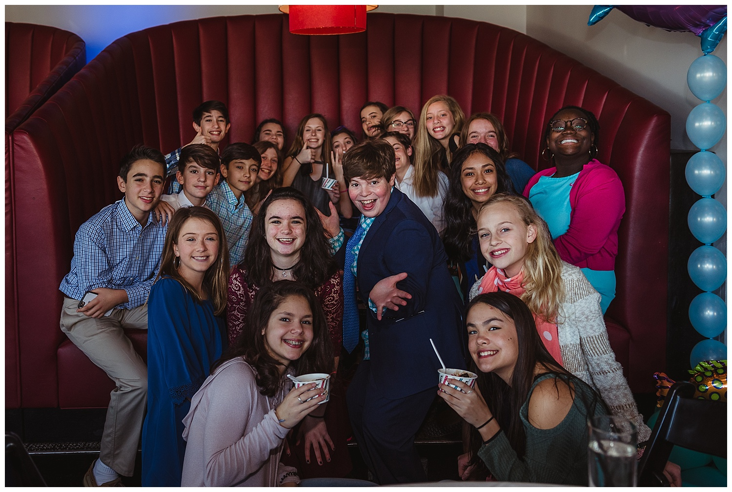 The mitzvah boy and his friends pose for the camera during his mitzvah celebration at Solas nightclub in downtown Raleigh, NC.