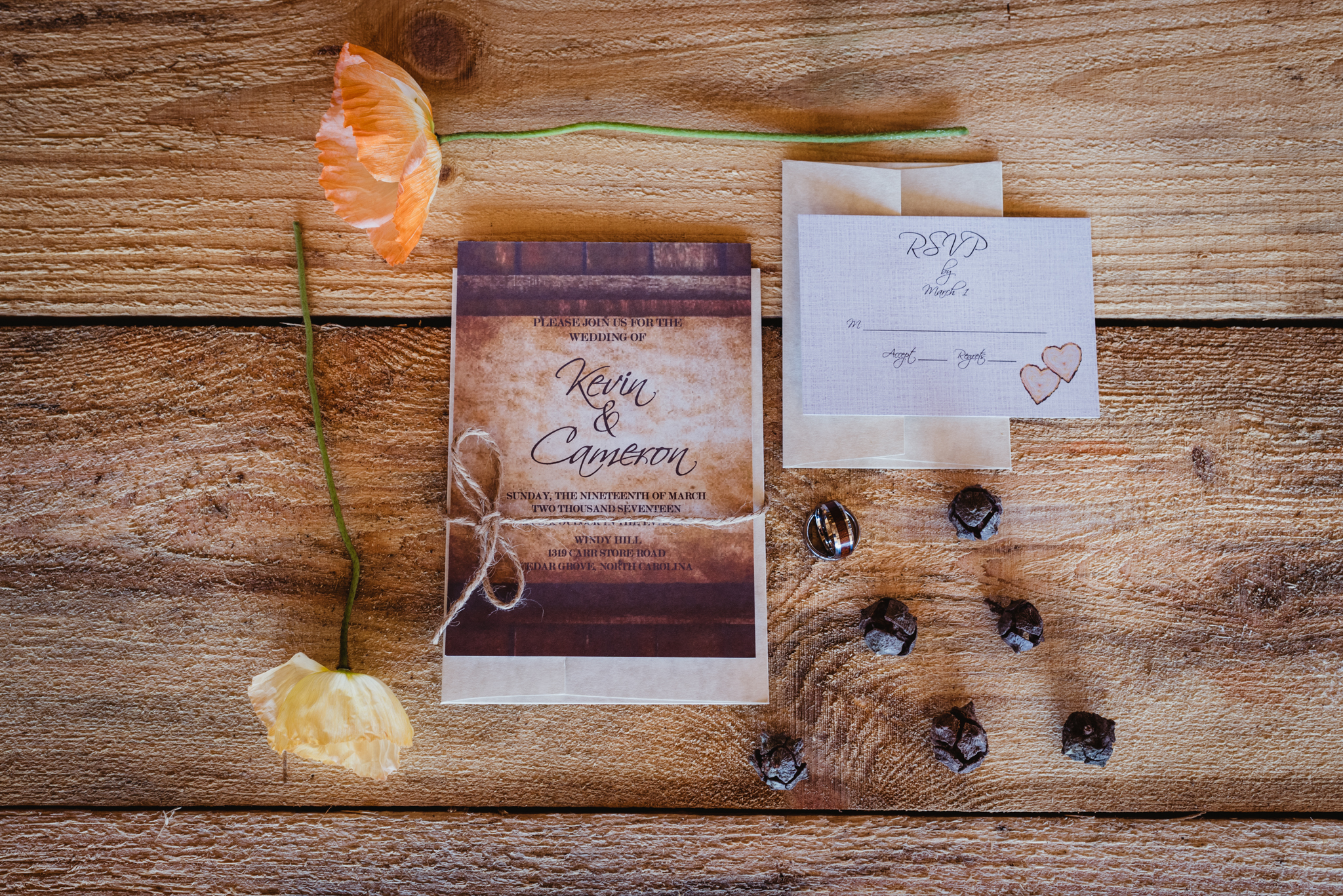 Rings, invitations, acorns and flowers adorn the farm table at the styled engagement session with Rose Trail Images at Windy Hill Farm near Raleigh, NC.